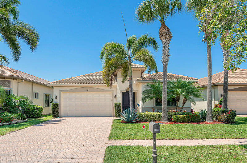 Wow! What a beautiful home! This completely upgraded 'New Delray Model' is now available for sale. This home is on a premium lake lot in close walking distance to the Four Seasons Community Clubhouse & Pool. Completely open living space overlooking a peaceful lake. Fantastic sunset views! Room for a private pool with plans available. Upgraded flooring and lighting throughout. Featuring 3 bedrooms including a huge master suite with beautiful bathroom and two large walk-in closets. Hurricane Accordion Shutters, New Washer / Dryer, Water Heater & Dishwasher. Included in the sale is a house generator. Chandelier Excluded. Clubhouse renovation and expansion coming soon with the assessment paid! 24H guard gated community. Moments from Delray Marketplace, Grocery Stores, Shops & Great restaurants