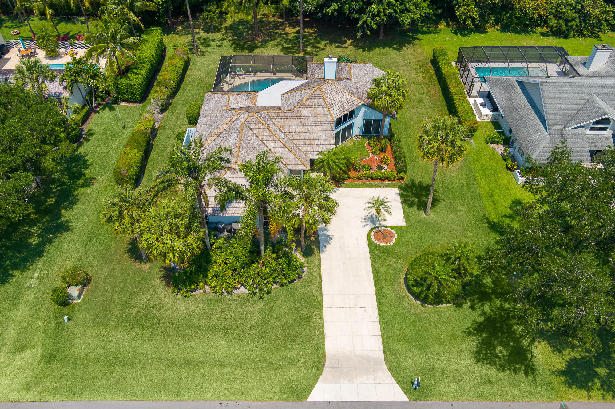 This 4/2/2 spacious single family pool home is located inside the highly coveted community of Whispering Trails in Jupiter. Once inside, the entry-level living area, high ceilings, and spacious floor plan immediately put the details of this home into perspective. Interior features include formal living & dining areas, wood burning fireplace, and a private den. It is situated on an oversized 1/2-acre lot with a private screened pool/patio. The serene community of Whispering Trails is perfectly located with quick access to the Florida Turnpike and I-95, and less than 6 miles from the gorgeous Atlantic Ocean and Jupiter beaches. Abundant choices for shopping, dining, sports, and entertainment are just minutes away. Cont'd . . . For the golf enthusiasts, there are several nearby daily or annual fee courses that provide challenging rounds. A commute to the Palm Beach International Airport is just a short drive, as are many family entertainment attractions. This home is not one to be missed. Come see what it is like to live in luxury without the high costs of mandatory memberships and high association fees.