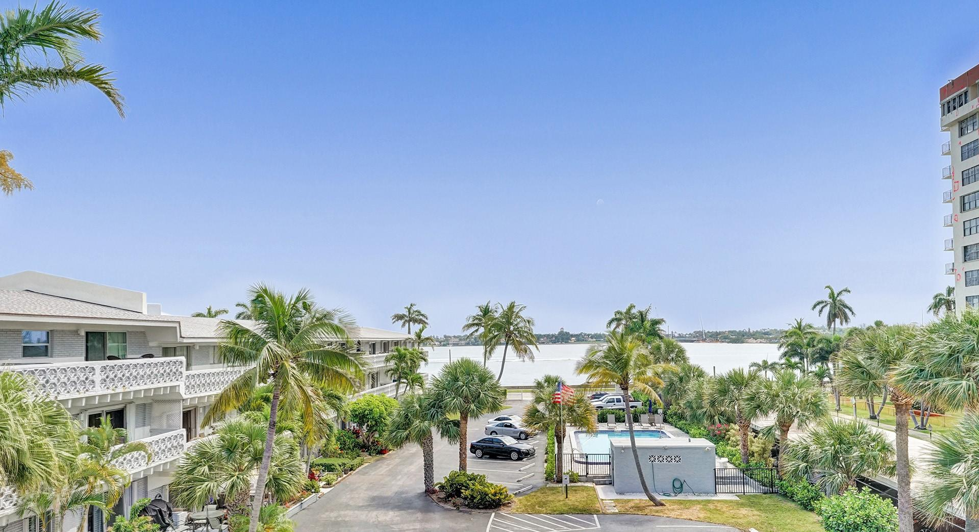 Hidden Gem located along the Intracoastal Waterway! Enjoy amazing views of the Intracoastal and Palm Beach Island from this light and bright updated top floor unit. Features include; hurricane impact windows thru-out, a large private balcony, updated kitchen with quartz counter-tops, built-in wine cooler, custom white cabinetry with an extended bar/workspace area, stainless-steel appliances and an updated bath.  This unit also features lots of closet space with an additional exterior storage unit. Just minutes to the beach, downtown area with great shopping and restaurants.