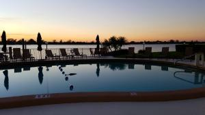 ENJOY A GLASS OF WINE, & AMAZING SUNSETS FROM DIRECT INTRACOASTAL BALCONY ON THIS 1-2 BDRM, 2 BATH UNIT. METICULOUSLY MAINTAINED CO-OP WITH 24/7 DOORPERSON, F/T MANAGER & MAINTENANCE STAFF. GYM, SOCIAL RM, BBQ'S BY BEAUTIFUL POOL DECK, KAYAK STORAGE W/ LAUNCH SLIP AND DOCK SLIPS UPON AVAILABILITY. ACROSS FROM FOUR SEASONS RESORT & THE BEACH!