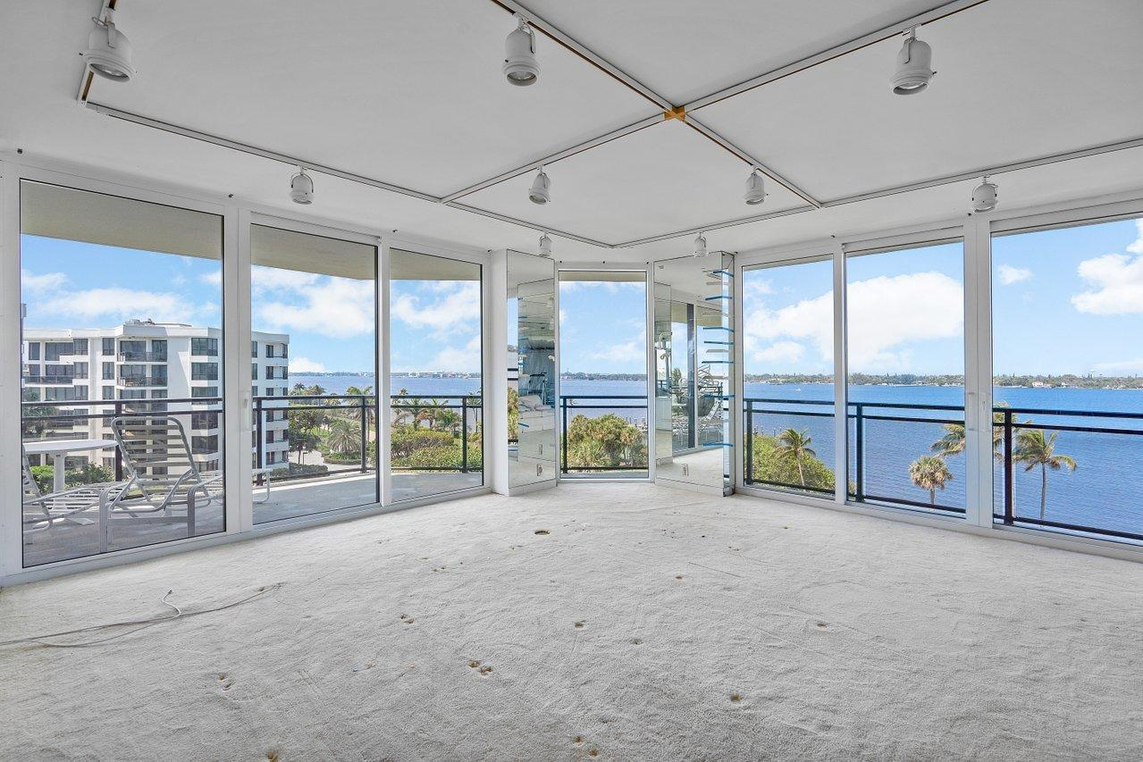 This magnificent Southwest Corner location offers spectacular sunset views over the Intracoastal Waterway and soothing Ocean views. There are brand new hurricane impact doors and windows .This is a fabulous opportunity to purchase and recreate your Palm Beach dream home. The Palm Beach Hampton has been completely renovated and is one of the areas most beautiful oceanfront buildings. It's situated on 800' of prime oceanfront, 24/7 manned gatehouse and doormen, outstanding fitness facility, 2 tennis courts, club-room with billiards and card tables. The pool area is outstanding and offers a BBQ and hot tub. There are 2 garage parking spaces. Pets are welcome! PROPERTY BEING SOLD AS IS - NO CREDIT WILL BE GIVEN BASED ON THE INSPECTION REPORT