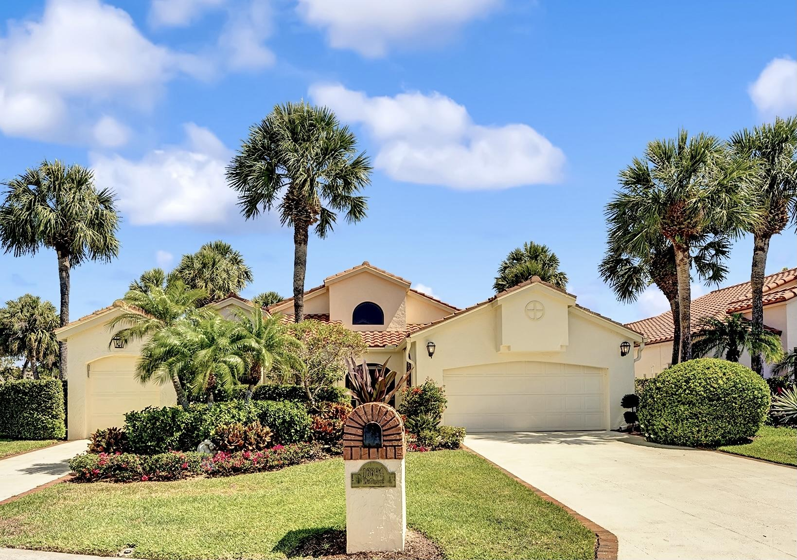 Situated in Jupiter's highly sought after Jonathans Landing, this home will not last long! 16694 Hidden Cove Drive is a rarely available property, located in the Hidden Cove enclave. This charming home enjoys exceptional views East over the championship golf course's 18th hole and the marina & yacht basin. Located on a prime, corner homesite on the cul-de-sac, this property affords the ultimate in country club living. 3 BR and 2.5 baths, screened in patio with expansive views, and in immaculate condition. Updated interiors, and elegant furnishings provide for a move-in ready option. A full two car garage, along with separate golf cart garage provide added security and convenience. This property is being sold fully  furnished.