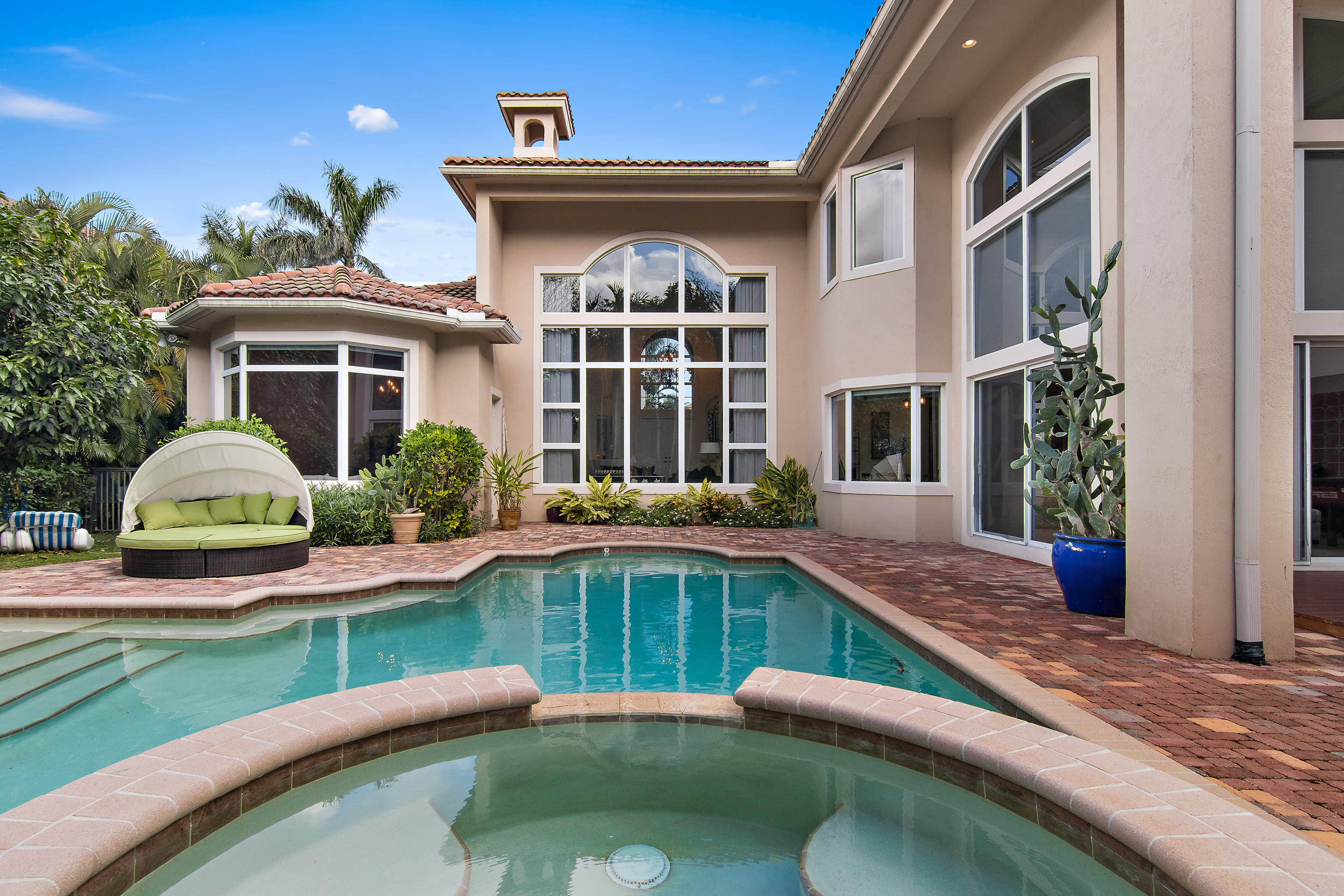 This five bedroom, custom home with mature plantings and oversized pool epitomizes a pampered, yet casual Florida lifestyle. Aaron Slims in Palm Beach. Polished marble floors, soaring ceilings, new wood floors on stairs and upper living areas. Panoramic windows showcase a picturesque backyard with heated pool and spa in a private gardens setting. Large lot allowing for privacy. Inside, there is a full chef's kitchen; dining room with exposed, French brick. Master suite has ample dressing area, built-in closets, roman tub and oversized shower. Generous bedrooms throughout, plus office, wet bar and upstairs loft. ALL IMPACT GLASS and full home generator. Numerous upgrades in this sought after Casa Del Sol model. (see supplement). Frenchman's offers state of the art tennis, golf, pool, gym, restaurants and spa. 24 hour manned gate. Clubhouse was recently renovated. Close to beaches, entertainment, fine dining, shopping, private and public schools. SPORTS membership with this home, but may upgrade to GOLF. New Stove, one newer AC, new dishwasher, painted, kitchen and master renovations, inside and out freshly painted.