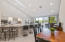 Open kitchen with multiple areas for casual dining