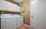Laundry room with newer washer/dryer and storage