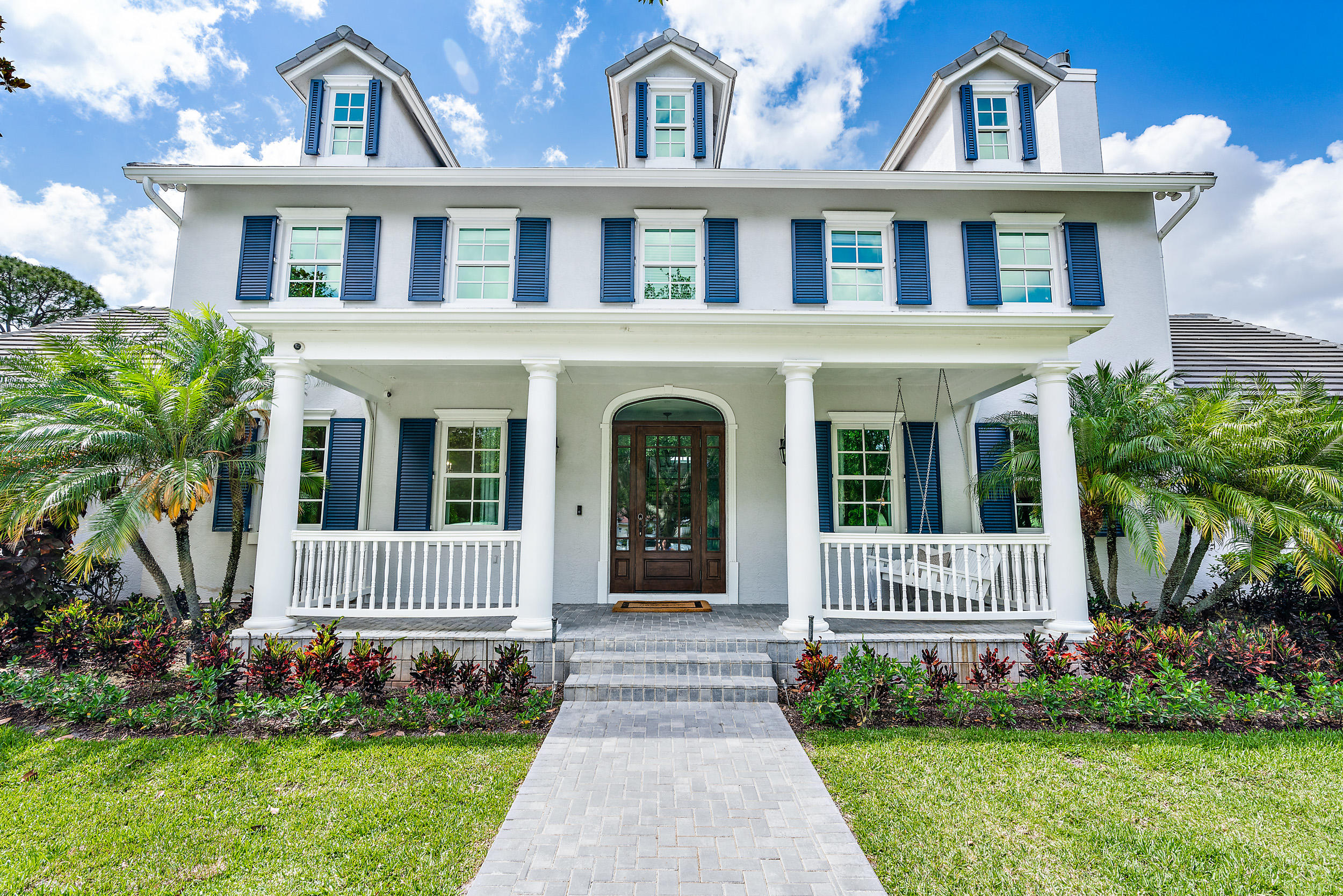 Don't miss this beautiful home in the prestigious community of Steeplechase! This flawless 5 BR home + office has been superbly renovated with a newer (2018) roof, new tennis court (2021), Lynx built-in natural gas grill (2020), whole house generator (2020), top of the line kitchen w/ sub-zero + thermador appliances, quartzite counters with lights & much more. This stunning home boosts impact windows, 4 A/C units, SWAT mosquito system, GFI charging outlets + a tankless water heater. Perfectly situated on a beautiful lot w over 1.6 AC of beauty.  Pull up to this gorgeous home by driving down a long and winding driveway just to be greeted by an inviting front porch with swing. Be amazed by the hand-scraped wood floors, wood burning fireplace and light & bright feel of this spacious home. The master bedroom suite is located on the first floor with a large master bathroom & walk in closet.  You will find all guest rooms upstairs & an additional bonus room on the second floor on the other side of this well-planned home.   Don't miss the large garage with GFI outlets for charging electric cars tucked away in the back of the home.   Come outside to beautiful landscaping with custom lighting to enhance your outdoor experience. Enjoy the tranquil pool, jacuzzi, outdoor kitchen, fruit trees including Avocado, Banana, Fig, Papaya and more!  Impeccably kept home with whole house generator, SWAT mosquito system and a brand new tennis court!  Steeplechase is a highly sought after, family friendly community, close to I-95, the Turnpike, and Palm Beach Airport. Perfectly situated within a man-gated community, with luxury estate homes and tree lined streets. Steeplechase is a unique Residential home community, located in the heart of Palm Beach Gardens, minutes fine shopping, educational resources, beaches and golf courses.
