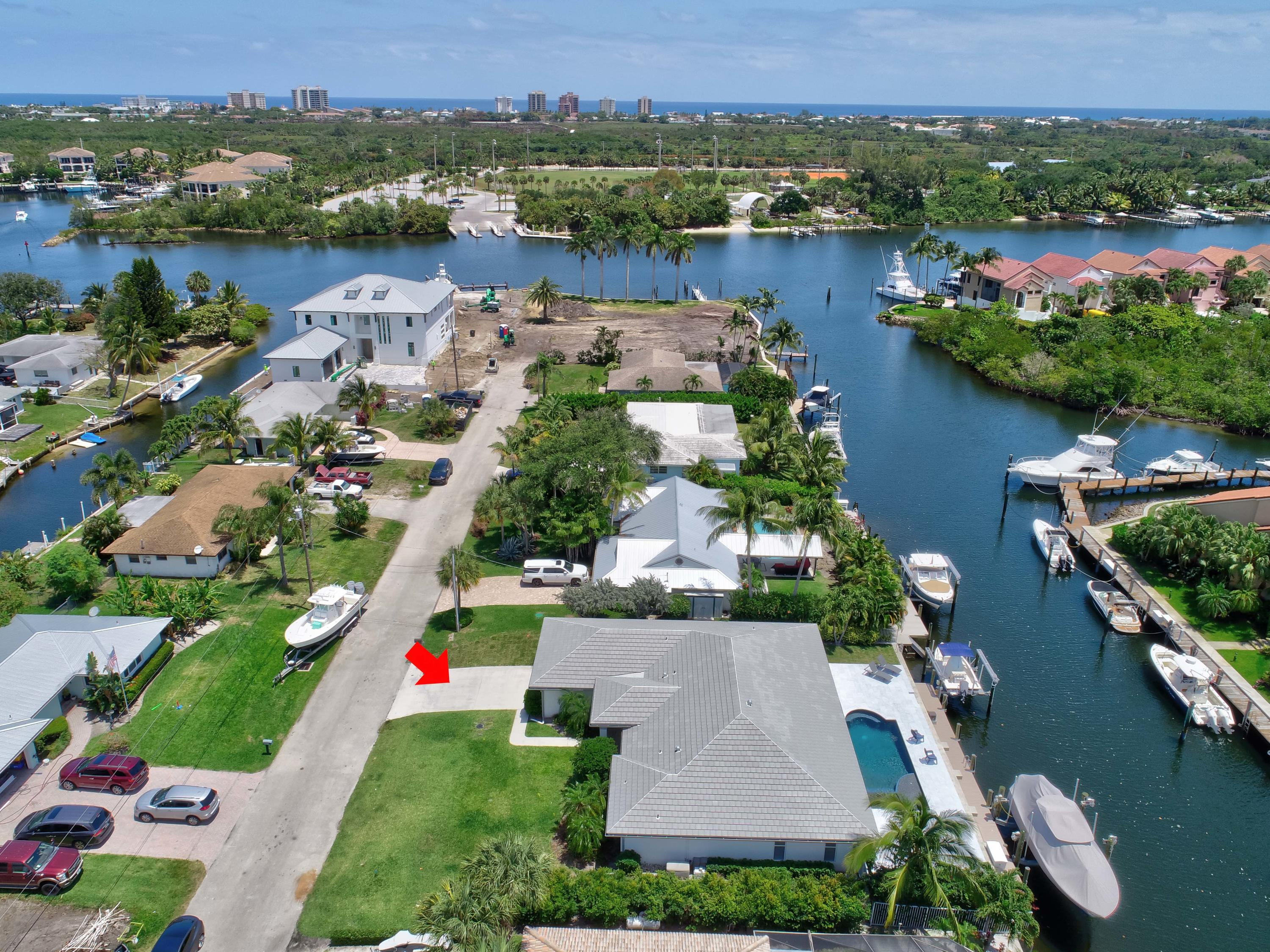 A Boater's Dream! Located in the heart of Palm Beach Gardens, this stunning intracoastal pool residence has been completely renovated and features 90 Ft of water frontage, 2 separate boat lifts (10K in 2017 and 20K in 2019), new dock (2017), and NEW roof (2020) with picturesque water views, no fixed bridges and direct access to Palm Beach and Jupiter inlets. Meticulously updated and impressive upon entry, this expansive open floor plan has beautiful wood plank tile floors, Level 5 flat smooth finish walls and ceilings, new interior paint, new Plantation shutters, new fans, fixtures and custom California closet systems throughout. Tastefully decorated, this inviting home is encased with tons of natural light and offers a separate dining room with beautiful lighting and custom fixtures. Lavish gourmet kitchen completely remodeled with soft close cabinets, Pompeii Quartz countertops with large center island, subway tile backsplash, top-of-the-line Bosch stainless steel appliances, custom pendant lighting, and built-in bench seating in breakfast area. Generous master suite with designer wall treatments and walk-in closets. Luxurious master bath boasts Quartz counter tops, dual custom vanities, separate jacuzzi tub, large frameless glass shower complimented by subway tile, designer cut-outs and custom shower flooring.  Extras galore include surround sound, whole house Kohler generator with 500-gallon propane tank, new hurricane front doors, new gutters, Ecobee smart thermometer and Lutron smart switches, Emtek hardware throughout, and new entryway and porch tile flooring. Separate laundry room with oversized front load LG washer and dryer and abundance of storage space. Bask in your stunning outdoor paradise! Spacious covered patio updated with shiplap ceilings, new fans and LED lighting, spectacular brand-new saltwater pool complete with Pentair pool equipment, new sandblasted marble tile around pool deck and sweeping intracoastal canal views from your private fenced backyard.  Flawlessly maintained and decorated to perfection, this intracoastal home exudes first class quality and the finest details that are rarely available in Palm Beach Gardens!