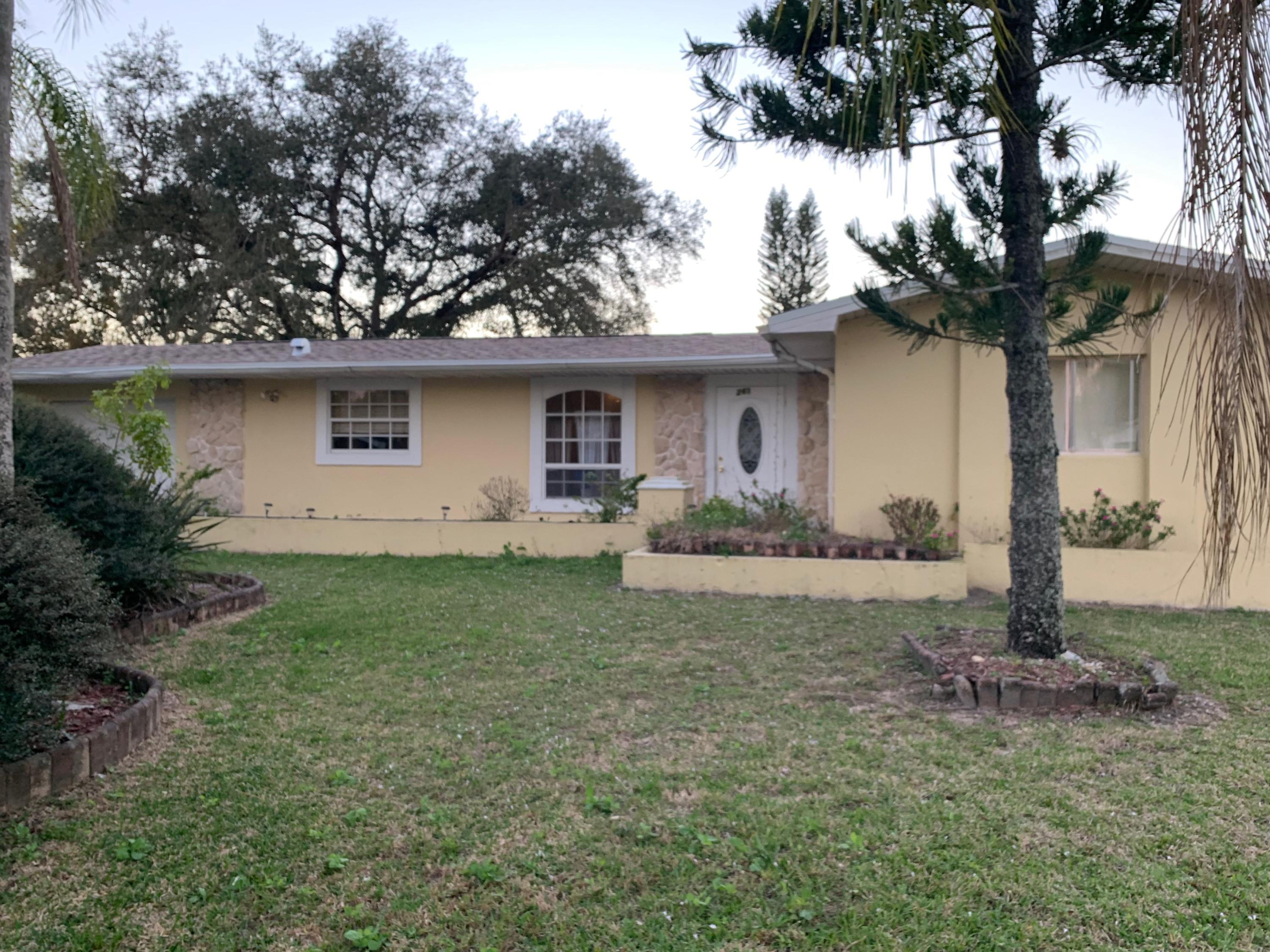 This house offers a 4 bedroom and 2 full bath and 1 car garage. There is a separate entry on the side of the house to the back bedroom if you wanted to rent it out for additional income. The property has county taxes but has city water and sewer. Located close to 25th St.  US1, and miles to interstate 95. Don't let this property pass you by, great for primary or investment property.