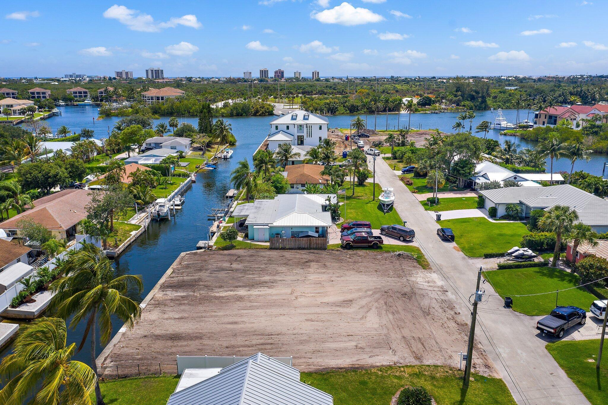 BUILD YOUR DREAM HOME! Unbelievable Waterfront Property With No Fixed Bridges, in the Heart of Palm Beach Gardens. Bring Your Boat! This Lot Sits on a Deep Water Canal and is a Stones Throw From the Intracoastal Waterway! Watch the Annual Holiday Boat Parade From the Privacy of Your Backyard, or join in on the fun! Located in Unincorporated Palm Beach County, lower taxes, NO HOA, No Restrictions!This Property is Shovel Ready! Permits are in to Construct an Unbelievable 3,400 sq ft 4 Bedroom/ 4.5 Bathroom Key West Inspired Semi-Custom Pool Home! Or, Scrap Those Plans and Design/Build Your Own Completely Custom Dream Home Along One of the Most Desirable Waterfront Communities in Palm Beach Gardens. A True Boaters Paradise- Don't Miss Your Chance to Build and Live Where Others Vacation