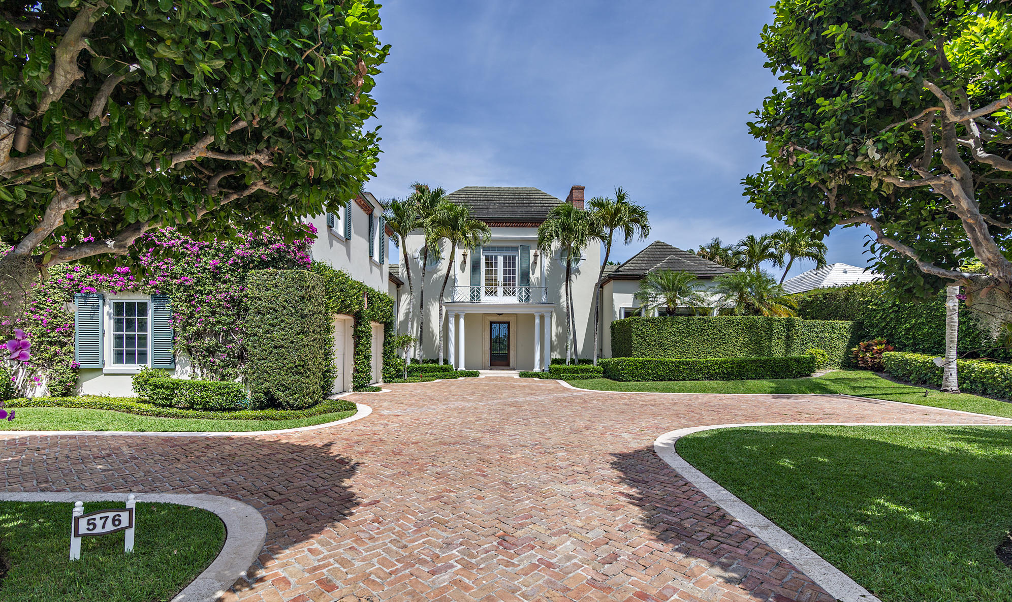 Presenting Todd Michael Glaser's newest Legacy  home on Palm Beach's Everglades Island. Direct waterfront with a dock and panoramic views overlooking the Everglades Club golf course. This 16,000 sq.ft. lot has 100 ft. of waterfrontage. The house boasts soaring ceilings throughout, the downstairs master suite features vaulted ceiling, his and her master bathrooms and 2 enormous walk-in closets. There are 4 additional bedrooms and 5 bathrooms in total plus 2 half baths. Large covered outdoor loggia overlooking the swimming pool creates an ideal setting for entertaining. Completion date for the renovation is scheduled for October of 2021. Other amenities include a full house generator and a 2 car garage. Roof was replaced in 2006. Impact windows and doors throughout except the three sliding doors in the living room.