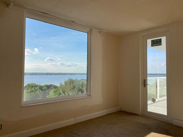 The direct intracoastal VIEWS from this spacious sixth-floor 1 bed / 1 bath are truly inspiring...ready for renovation...hurricane impact windows and door installed in January...assessment paid in full...comprehensive building restoration underway; includes new roof, updated electrical, plumbing, concrete restoration, new balconies, glass railings, new pool area, renovated hallways...this Palm Beach classic is transforming into a Modernist dream.Low maintenance...rent once per year, after the first year...The Patrician is an oceanfront building...with unobstructed views east and west.Make it your own...and enjoy the most beautiful sunsets and open views from West Palm Beach to Hypoluxo Island. Grocery and dining options nearby...easy access to 95 and airport...live your dream.