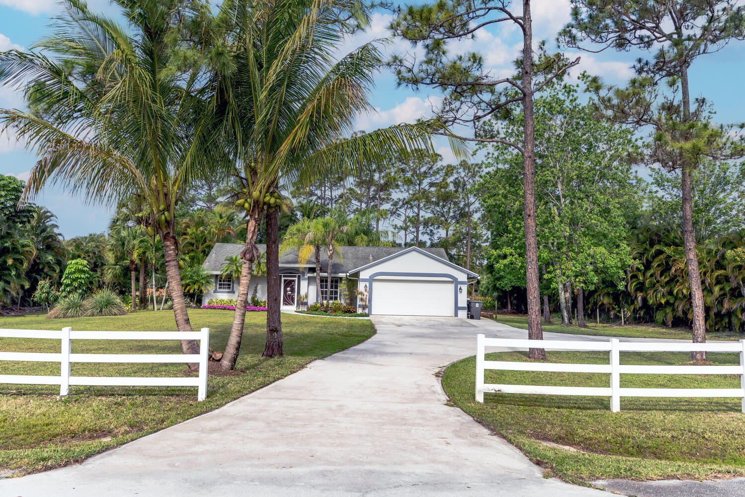 This immaculate 3 Bedroom, 2 Bath,  Pool home, CBS Construction, built in 1993,  fully fenced secluded back yard on 1.09 acres in highly desirable equestrian community, Jupiter Farms. Minutes to all the conveniences including major highways. 25 min to PBI airport. AC & HWH 2yrs old. Expansive concrete driveway. Pool is screened, solar heated.12x20 shed with electric and water connected.  Reverse Osmosis water system in home.New 6 zone sprinkler system, Lush tropical landscaping.
