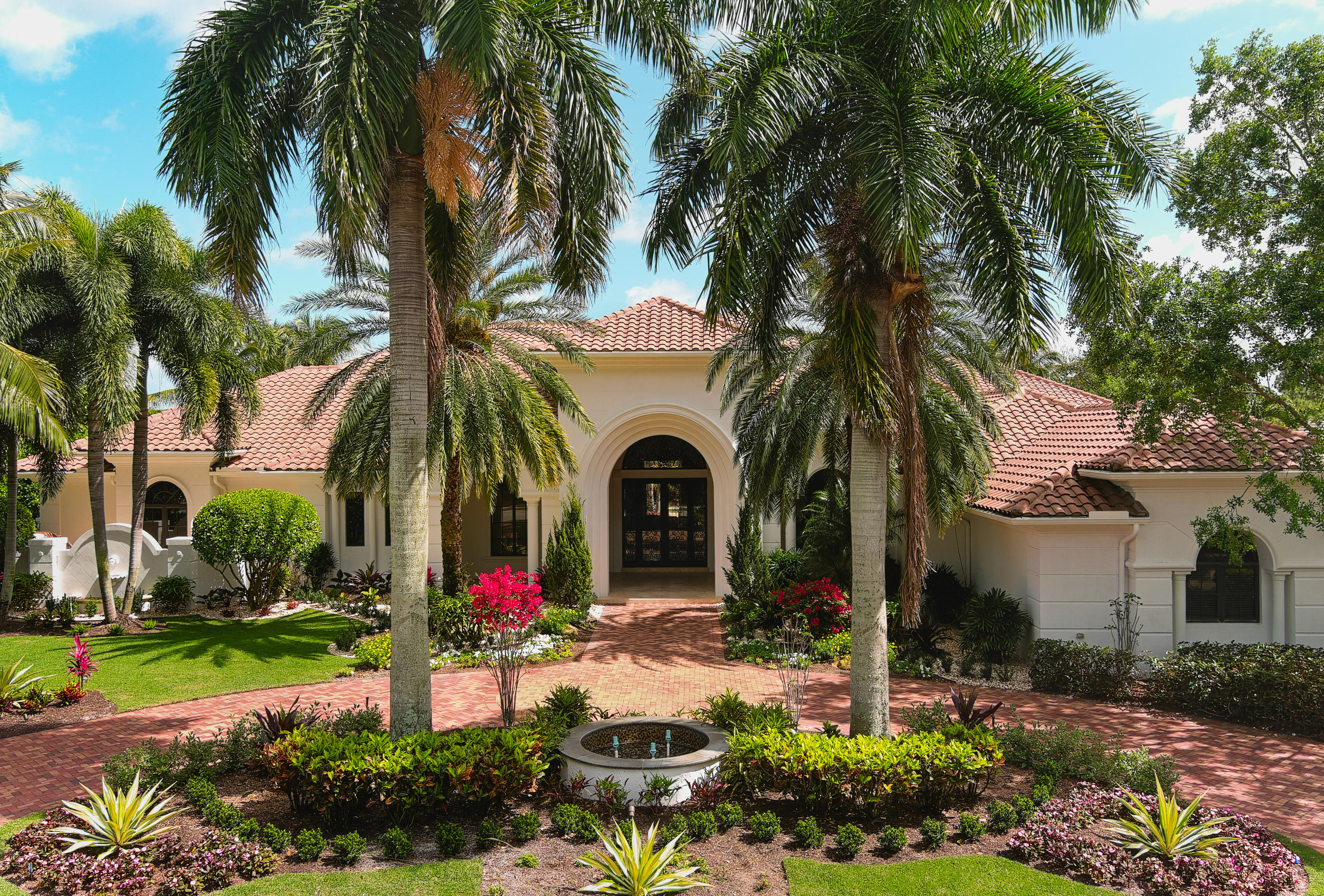 This magnificent, recently renovated 8, 234 sq. ft of living space home is not to be missed. Located on a very private acre lot with the best views of the lake and the fairway of the Par 5, 12th hole at Old Palm. Freshly painted inside and out, complete hurricane impact windows and doors and full house generator. This master bath has been fully reimagined with His/Hers separate baths and closets and gorgeous new countertops finished in a beautiful white/blue quartzite. New flooring throughout the home in a light ceramic tile. Kitchen has gorgeous custom cabinetry with calcite and quartzite countertops and eye catching cobalt blue island. The Butler's Pantry is finished in the same cobalt blue and is simply spectacular. Large formal and informal gathering areas including club room and spectacular home theatre leave plenty of space to gather with friends and entertain. 4 ensuite bathrooms, laundry/ pantry complete this home. 5 car garage plus golf cart off of driveway with large circular driveway in front of home - perfect for guest parking. This is one of the best offerings available in Old Palm today!