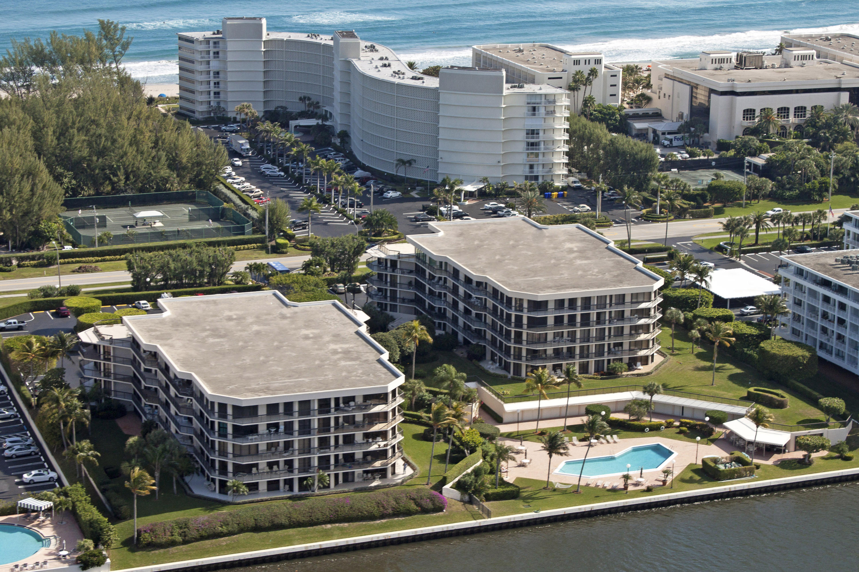 This is a real stunner! The only Intracoastal luxury building with garage parking in Palm Beach priced under 2M. Exposure is NW and just one unit east of the water. If you are seeking the finest finishes, this newly renovated two bedroom was reconfigured with an added half bath and open floor plan and gourmet kitchen. New Gym, Lobbies, Hallways and Clubhouse on pool deck, Close to Four Seasons Resort, Farmers Market, Par 3 Golf Course, shopping and restaurants.. Deeded garage space 29, outside # 41