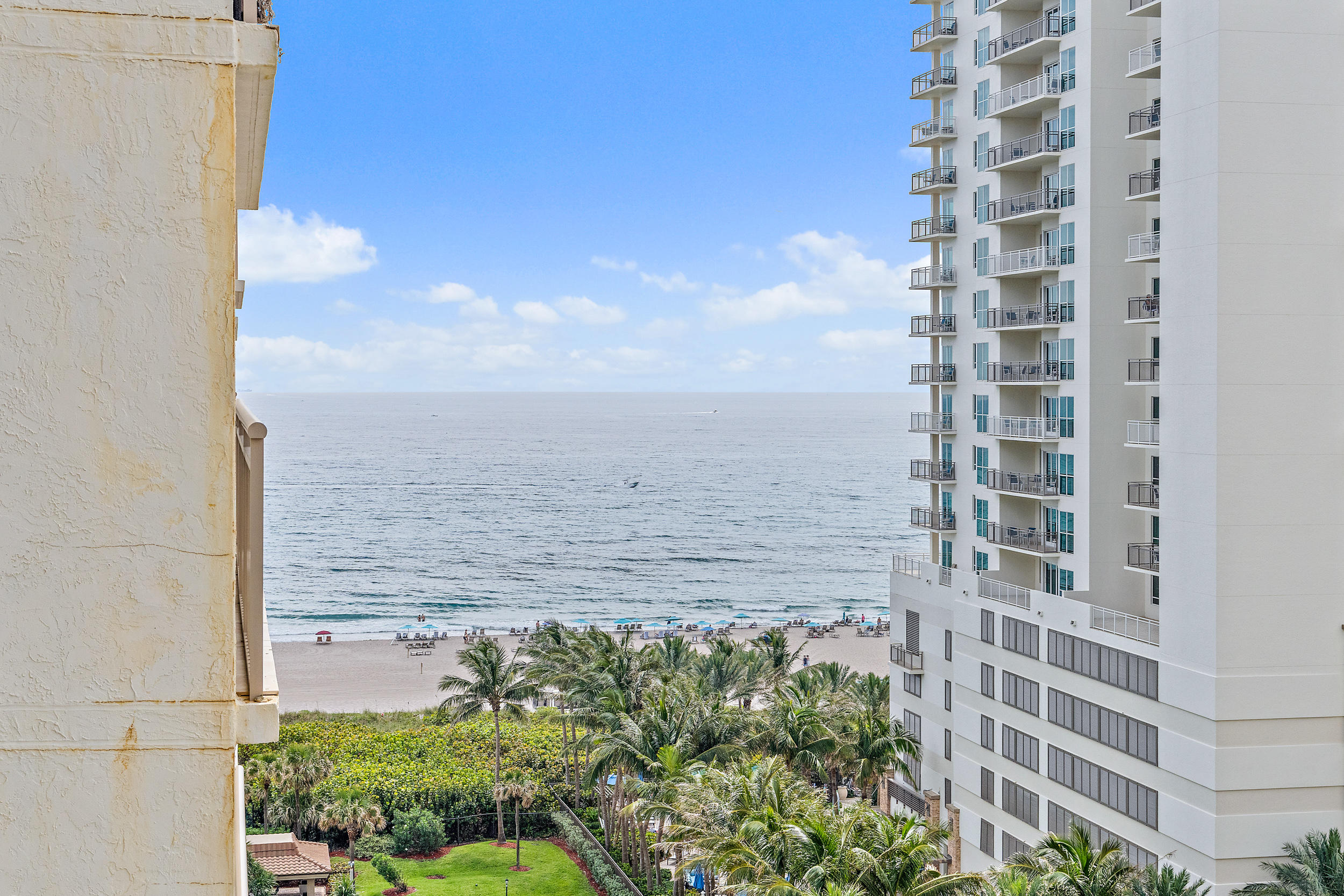 This well-cared for southwest corner condo has beautiful views of the night lights over the city as well as the ocean views from the terrace and Intracoastal Waterway from the living area and second bedroom. Oceantree is well-known for its lushly landscaped sprawling grounds. For those who enjoy an active lifestyle there are 3 tennis courts. The split bedroom floor plan offers 1,479 square feet of airconditioned living area, a spacious wrap-a-round terrace, newer appliances including brand new refrigerator and 2 year old dishwasher. There is a full appliance Climate Control warranty that is good until 3/17/2022. The floor to ceiling sliding doors are all hurricane impact glass and there is a parking garage. Umbrella and beach chair service included in HOA. Oceantree sits on three acres of beautifully landscaped grounds ideally situated on the beach at the southern end of Singer Island a short distance from the island shopping area and restaurants. Amenities include a wide sandy beach, beach service, two heated pools, Jacuzzi, Pavilions with barbecue grills, library-card room, exercise room, saunas, 3 tennis courts, 24 hour concierge service, and parking garage.