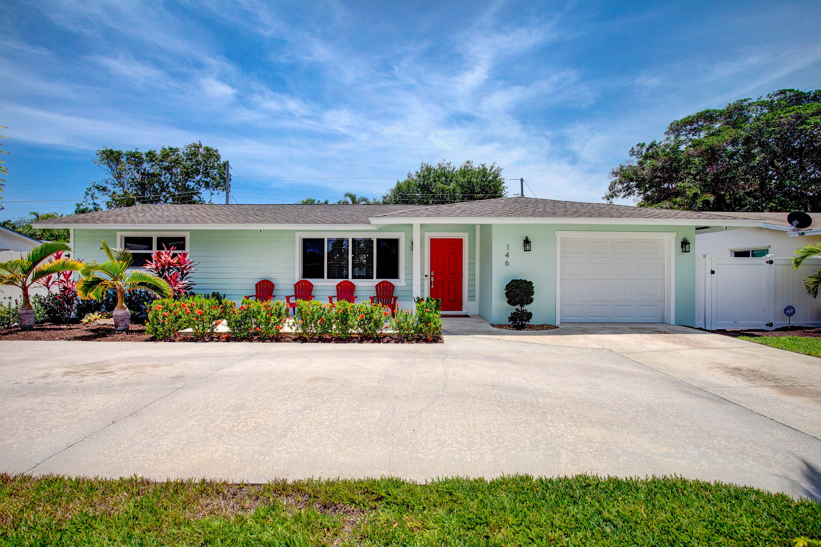 Location, Location, Location! This Beautiful Single Family Home located in the heart of desirable East Boynton Beach has been fully renovated both inside and out!!  The home features a split floorplan which includes 3 bedrooms 2 baths and a 1 car garage. Beautifully Landscaped with a new sprinkler system that is WiFi Automatic!!  The Large back yard is fully fenced in with new vinyl fencing.  There are two nice size patios one in the front and one covered back patio with gorgeous ceilings made from Pecky Cyprus and new tile with plenty of room for your loving pets, barbequing and entertaining your guests.  The Spacious circular driveway has plenty of room to store your cars, boats or recreational toys.  The new Kitchen has a 36'' Wolf Gas Range with hood, custom cabinetry, granite counter tops, new backsplash, stainless steel appliances and pendant lighting. Both bathrooms have been newly renovated and feature new tile, shower, tub with rainfall shower heads marble and quartz countertops.  All natural gas appliances, including tank less water heater, dryer, range outdoor grill and stand by generator. Entire house has a water purification and water softener system, new AC system and ducts, electrical panel upgrade, recess lighting, new porcelain tile, Impact windows and doors including Garage door and sliding glass doors, new stand-by Generac Generator which powers entire house.  Exterior has been completely re-stuccoed and repainted.  House has natural gas and NO HOA!!!!  Don't miss out, A MUST SEE!  Won't Last!!