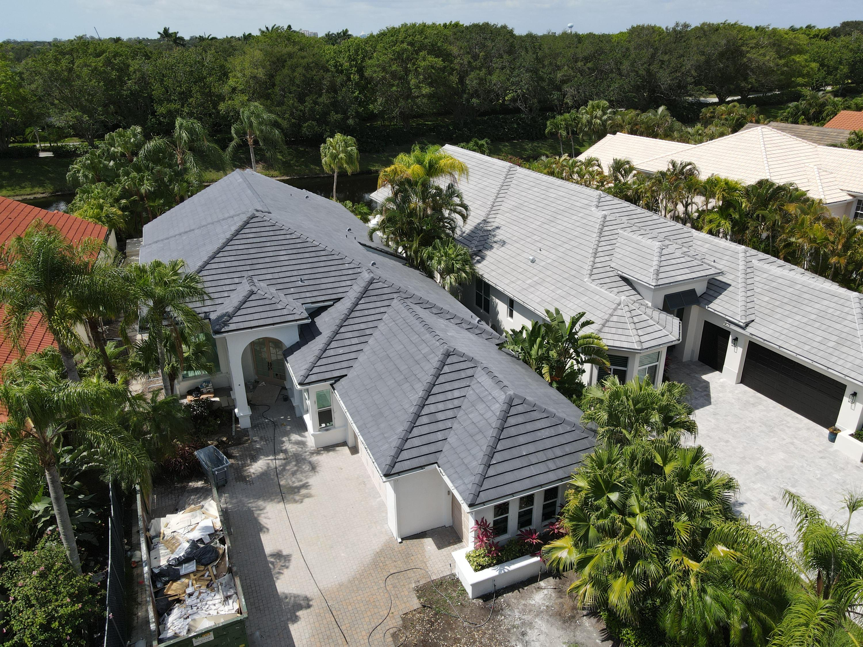 "Exquisite completely renovated rare Barbados model with serene water views, located in the luxury community of Frenchman's Creek Beach & Country Club.This open concept home boasts high ceilings, 2 bedrooms with a den,3.1baths,2.5 car garage with pool & spa.Spacious size master suite includes two walk in closets, large designer bathroom & connecting cabana bath that leads to your own private oasis. Upgrades include:new roof,hurricane impact doors & windows, A/C units,insulation,drywall,luxury kitchen w/ top-of- the-line appliances(please click More for full list.) Natural light illuminates and enhances every room. Luxury Country Club living at its finest with golf, tennis, full spa, multiple restaurants, state of the art fitness facility & Private Beach Club. Close Proximity to I-95. Brand new upgrades include: -Concrete tile roof -Hurricane Impact windows and doors -Hurricane impact garage doors -Finished garage floor -Air conditioning units and duct work -Insulation & drywall -Insulated interior walls of the den for a quiet working space, media or  ""zoom"" room.  -Overhead LED lighting -Kitchen with high end stainless steel Wolf and Subzero appliances, gas cook top with sleek hood, wall oven, microwave, dishwasher, 48' subzero refrigerator, custom cabinetry with upper & lower lighting, quartz countertops, 9 ft island with storage underneath, pop up electrical outlets and pendant lighting -Custom bar area with wine cooler, ice maker, and storage for entertaining -Porcelain tile throughout first floor -Custom base boards and casing throughout  -3.1 custom baths total with Toto toilets  -Quality interior doors & hardware throughout -Circular paver driveway -Matching front & rear exterior lighting  -New gas pool heater -Travertine pool deck -Modern tile & refinished pool & spa -Fresh interior & exterior paint -Low maintenance, modernized landscaping"