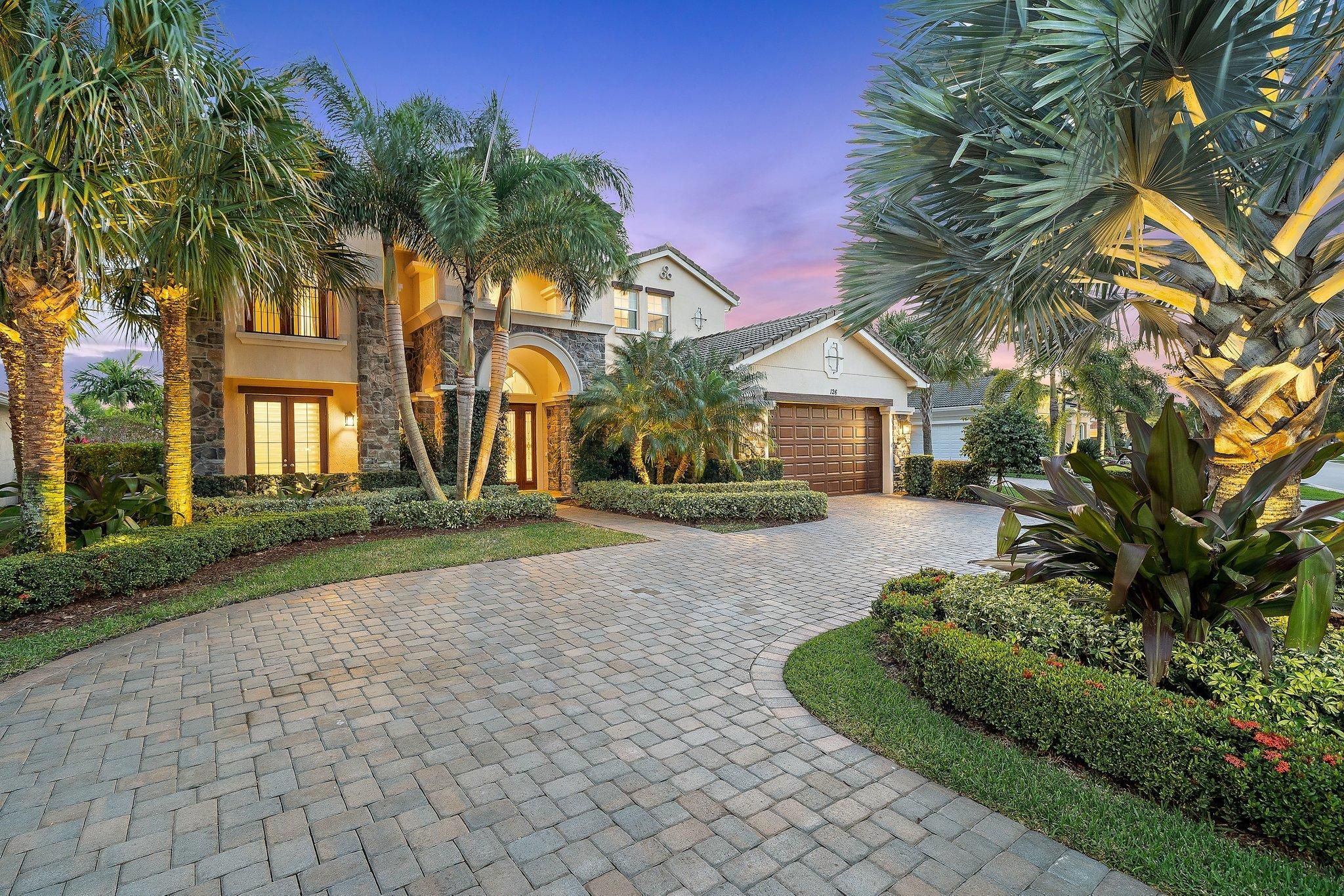 Rare opportunity to own a coveted Treanna floorplan in Prime Jupiter Country Club location (South exposure, lake + golf views, away from main roads).  This custom home has been outfitted by a top interior designer and features marble + wood flooring, craftsman woodwork +highest end design finishes.  Grand entry leads to formal living room w/ fireplace and floor to ceiling 2 story windows.  Kitchen features Wolf stove, upgraded appliances + walk in pantry.    Private downstairs office is complemented by built ins.  2 interior staircases offer easy access from BR's to kitchen.  This bright + airy home is designed to blend the best of indoor + outdoor living... Exceptional outdoor area w/ summer kitchen and Views!  Owners suite features lanai, luxe bath + HUGE closets!  Large upstairs loft. Jupiter Country Club offers Greg Norman golf + resort amenities including 6 har tru tennis courts, pickleball, 2 large pools (family + adult), fitness center w/ classes, bocce and formal + casual dining.   Enjoy Country Club living without the high equity costs and fees.  The Club is managed by Club Corp, a premiere resort management company - fabulous reciprocal privileges! Residents of JCC enjoy an active lifestyle set amidst a certified audubon preserve.   Gas lit sidewalks throughout the community, great for walking!  Jupiter Country Club is northern Palm Beach County's newest golf community.   Close to best beaches, shopping, dining, sport, medical + cultural venues.   All A rated schools!  You will love living here...