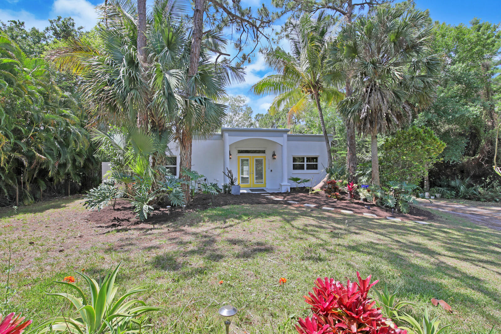 Serene and private retreat in Jupiter Farms with its own reflection pond. This 2/2 CBS home has hurricane impact glass windows throughout. French doors lead out to the screened lanai overlooking a fenced in free form pool. Less than 10 minutes from Riverbend Park and a short drive to shops, restaurants, and the beach.