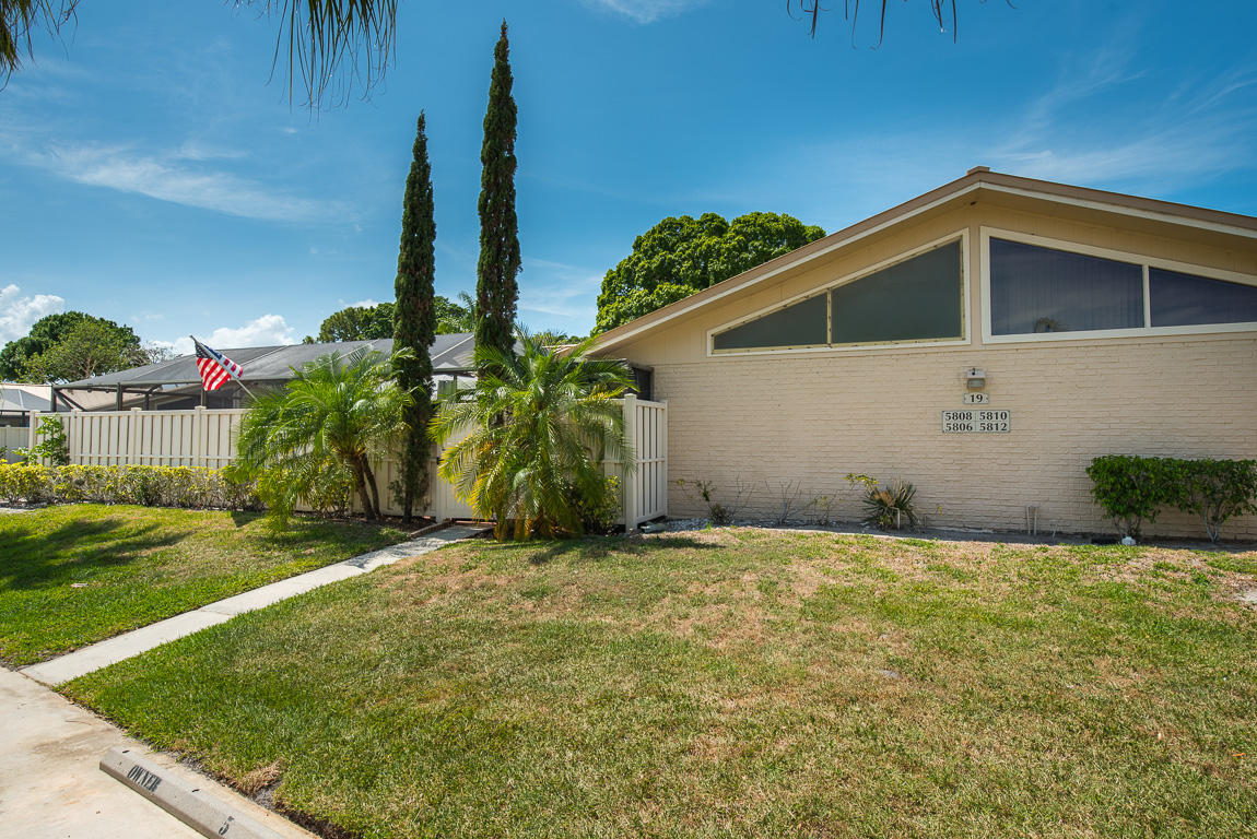 Amazing opportunity to own this 3BD|2BA villa with oversized screened in courtyard! Great layout with split bedroom floor plan and vaulted ceilings for lots of natural light. The open kitchen includes stainless steel appliances, granite counters, tile backsplash, and pantry. This home features tile floors in the main living and master, laminate wood floors in guest bedrooms and hallway, roof 6 years old (maintained by HOA), windows include hurricane accordion shutters, and A/C coils fully replaced in 2019. Westwood Gardens is a very active community, well manicured for with lots of amenities such as clubhouse, pool, tennis and basketball courts, to name a few. Very low HOA fees and pet friendly. Come see for yourself, will not last!