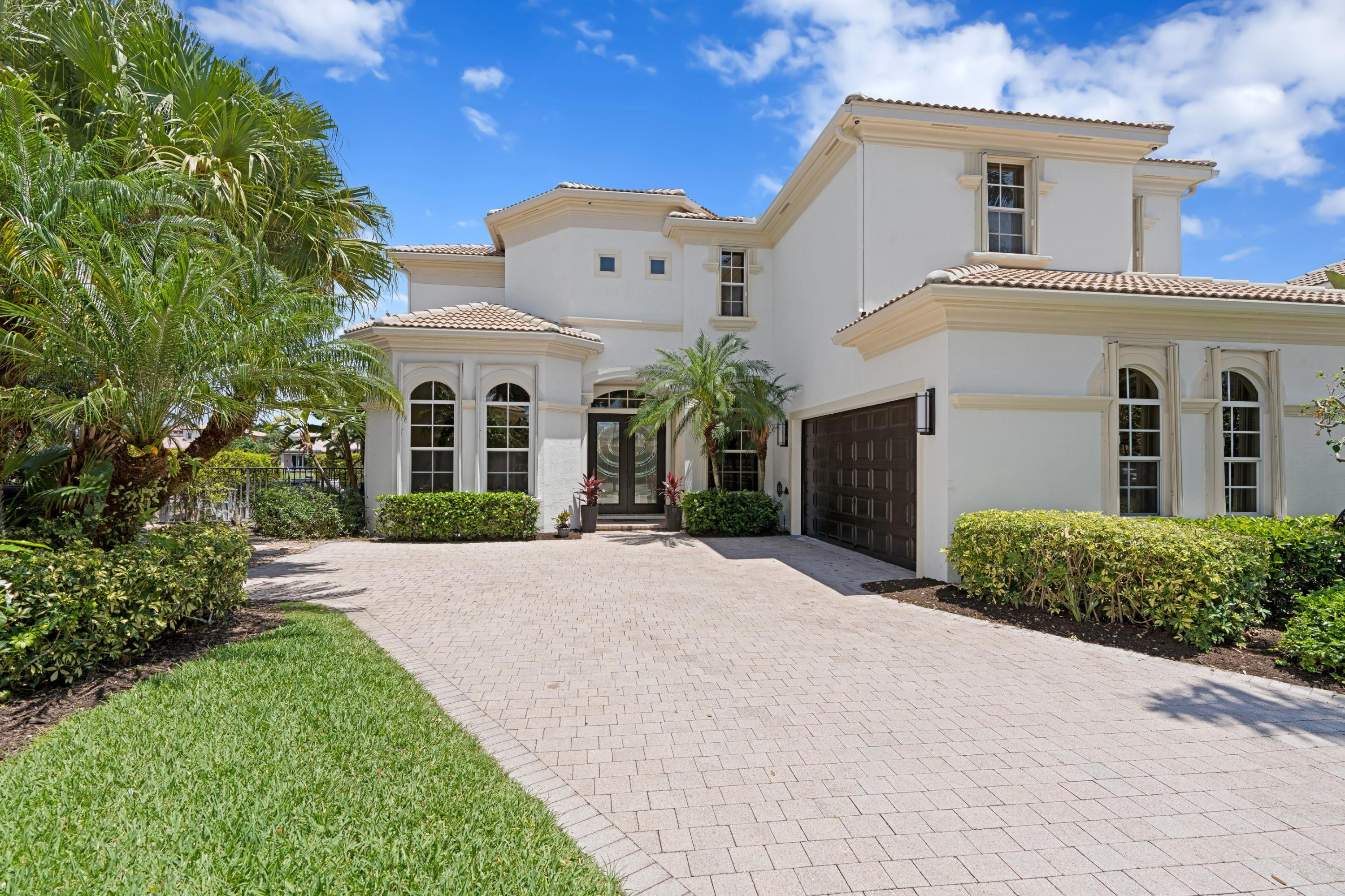 Unbelievable Views! RARE lot on cul de sac with 180 degree wide lake vistas. Entertain or be entertained by gorgeous Florida sunrises and sunsets. Completely redone smart home with modern kitchen, all new bathrooms, 48'' European porcelain tile floors, high tech security system, and a backyard with lap pool and spa that was recently retiled. Five large bedrooms all with en suite bathrooms. Large windows throughout the home. Light filled open floor plan on this highly sought out Seville model on prime cul de sac. This will not last. Mirasol Country Club is an award winning golf and tennis club with resort amenities, restaurants and nature trails. Close to entertainment, restaurants, beach, top schools and more.Capital contributions required to MMMA, MCA and Vizcaya POA. Full updates in ml