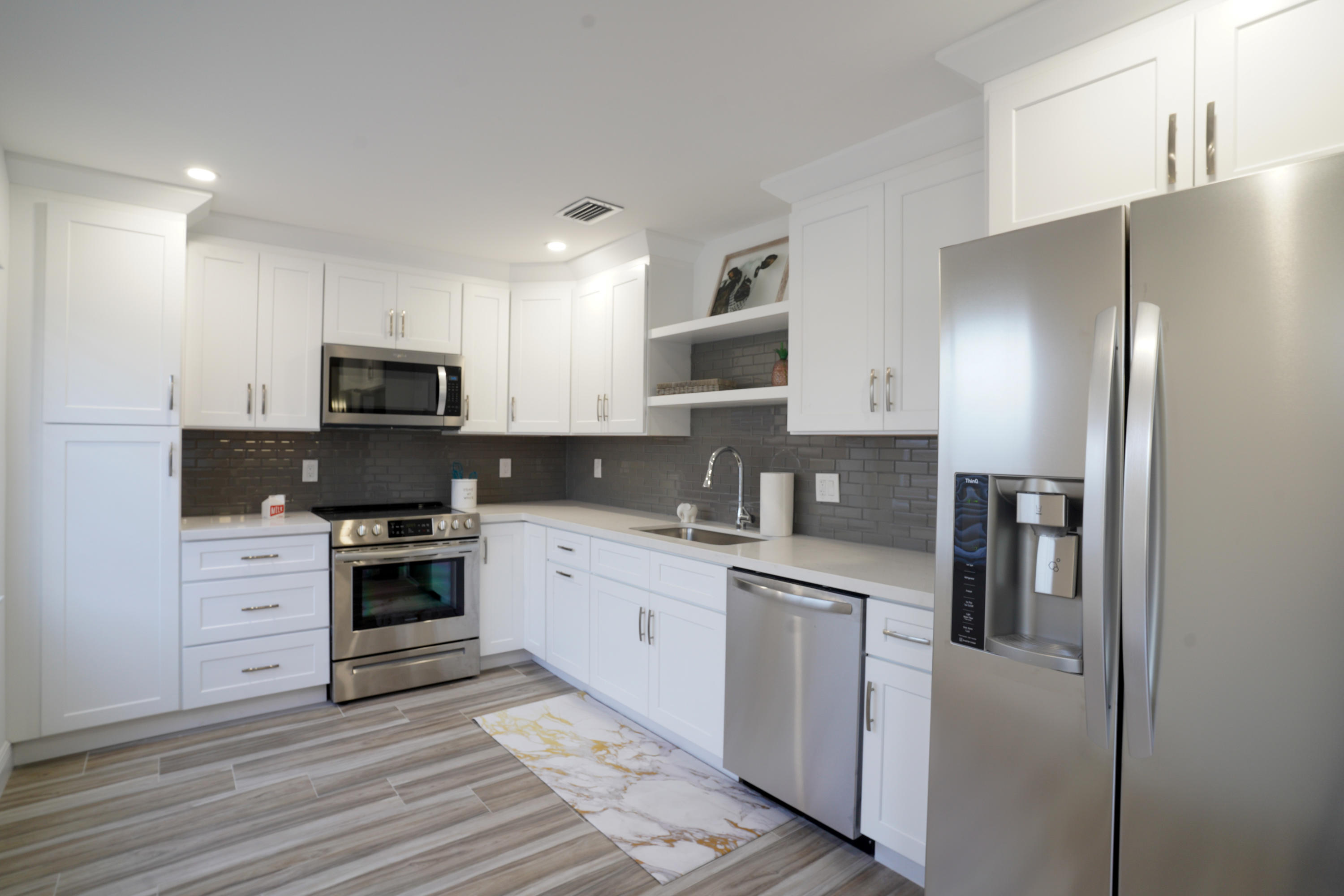 Beautiful home perfect for investor or owner.  Tile floors, wood shaker cabinets, quartz countertops, glass backsplash and much more.  ONLY AVAILABLE DURING TWO OPEN HOUSES SAT MAY 8 1230-4 AND SUNDAY MAY 9TH 10-1.  Make your best offer.  Can be rented right away going rate is approximately $2600.    NO FHA