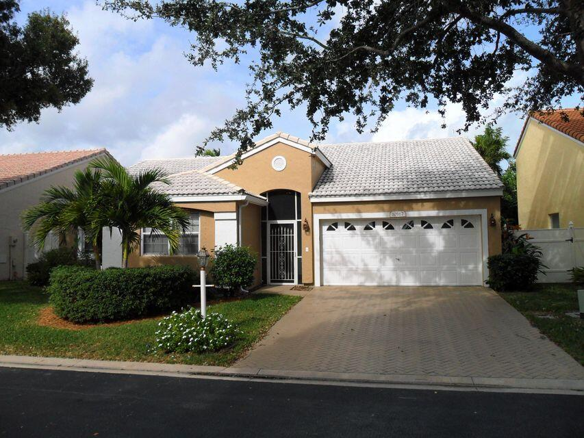 Beautifully updated 3 bedroom 2 bath 2 car garage one story home in Siena Oaks in Palm Beach Gardens.  Tile and laminate floors, updated kitchen with granite counters and stainless appliances.  Screened and covered patio, fully fenced back yard, 2 car garage.  Community offers pool, tennis, meeting space/club house.  Walk to Allamanda Elementary School.  Great neighborhood!