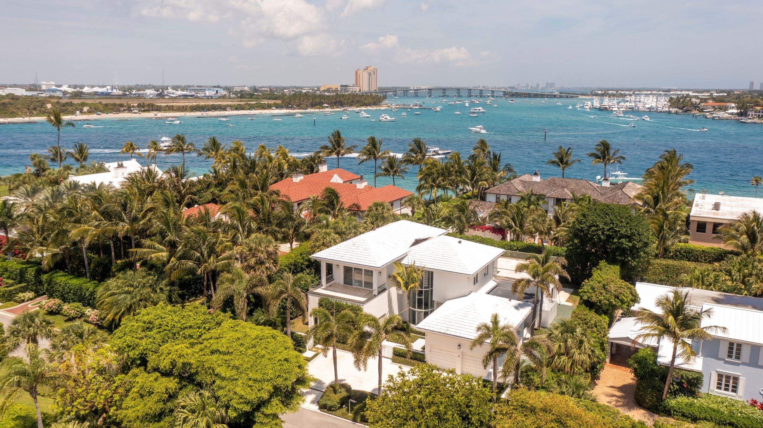 Mid-Century Modern gem on the North End of Palm Beach steps to the Ocean beach and the Intracoastal Waterway. This chic 5 bedroom, and 5.1 bath residence features over 7,000 total square feet, floor to ceiling windows that bring in the light, a large water view terrace overlooking the pool, stunning glass staircase, high ceilings throughout, gourmet eat-in-kitchen, spacious master suite with large closets, 2 car garage, mature manicured landscaping, and centralized lighting and audio system. All 5 bedrooms are ensuite. Stylish, glass edged upper deck with water view, perfect for entertaining. Ocean beach steps away at the top of Indian Road DISCLAIMER: Information published or otherwise provided by the listing company and its representatives including but not limited to prices, measurements, square footages, lot sizes, calculations and statistics are deemed reliable but are not guaranteed and are subject to errors, omissions or changes without notice. All such information should be independently verified by any prospective purchaser or seller. Parties should perform their own due diligence to verify such information prior to a sale or listing. Listing company expressly disclaims any warranty or representation regarding such information. Prices published are either list price, sold price, and/or last asking price. The listing company participates in the Multiple Listing Service and IDX. The properties published as listed and sold are not necessarily exclusive to listing company and may be listed or have sold with other members of the Multiple Listing Service. Transactions where listing company represented both buyers and sellers are calculated as two sales. The listing company's marketplace is all of the following: Vero Beach, Town of Orchid, Indian River Shores, Town of Palm Beach, West Palm Beach, Manalapan Beach, Point Manalapan, Hypoluxo Island, Ocean Ridge, Gulf Stream, Delray Beach, Highland Beach, Boca Raton, East Deerfield Beach, Hillsboro Beach, Hillsboro Shores, East Pompano Beach, Lighthouse Point, Sea Ranch Lakes and Fort Lauderdale. Cooperating brokers are advised that in the event of a Buyer default, no commission will be paid to a cooperating Broker on the Deposits retained by the Seller. No commissions are paid to any cooperating broker until title passes or upon actual commencement of a lease. Some affiliations may not be applicable to certain geographic areas. If your property is currently listed with another broker, please disregard any solicitation for services. Copyright 2021 by the listing company. All Rights Reserved.