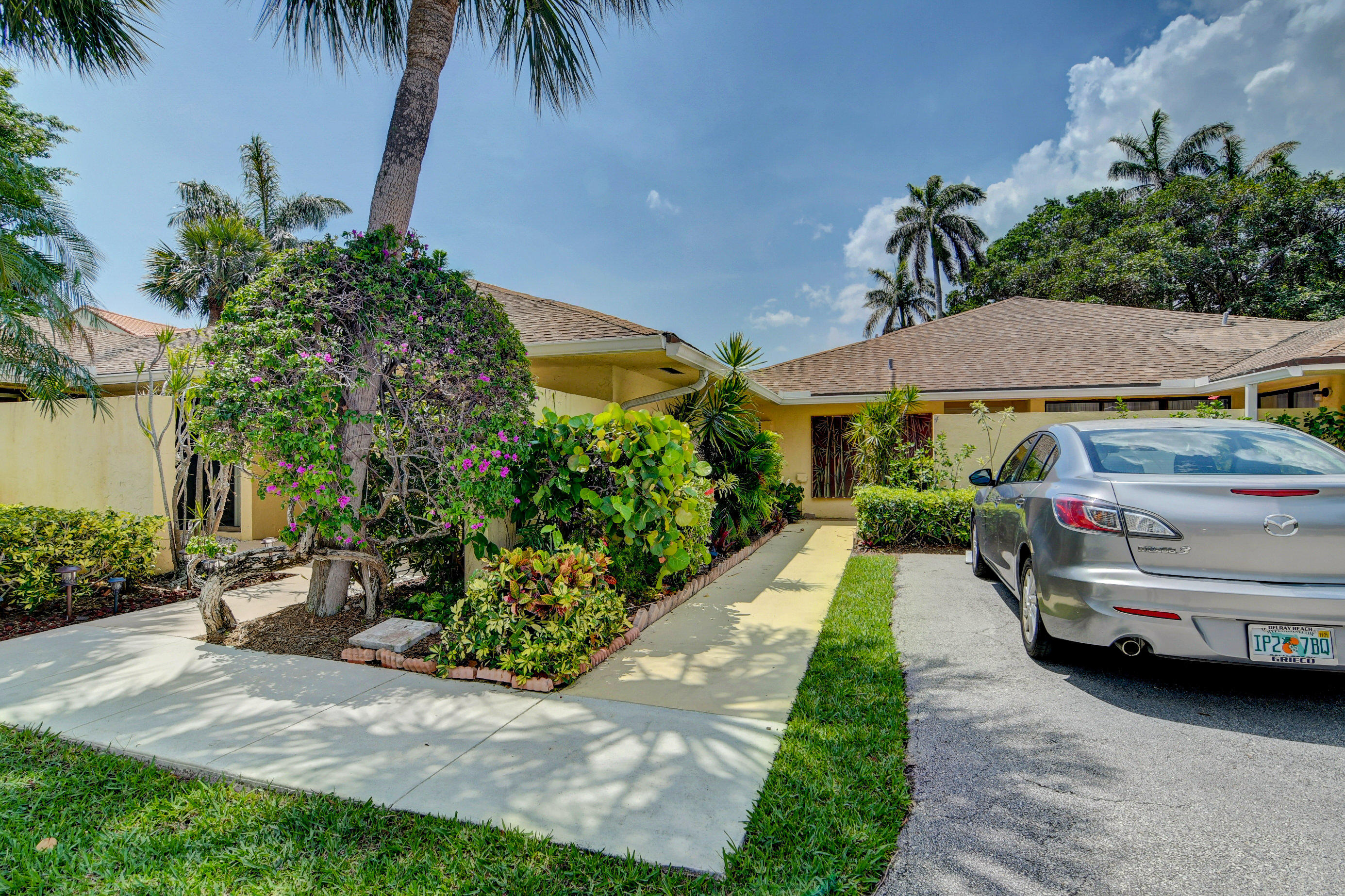 Welcome to Lakeshore, an intracoastal tropical gem, where every day is a vacation! Beautifully renovated 2/2 villa boasts a split floor plan, providing privacy for you and your guests. Open, light and bright, with updated white kitchen cabinetry,  granite and stainless appliances.  Bathrooms have been completely redone, with neutral tile and oversized master shower.  Brand new AC.   Lovely park-like view in back.  Villa is steps from intracoastal heated pool, spa and gazebo, where you can sip your favorite beverage while listening to the soothing waves.  Like kayaking and paddle boarding?  Bring your water toys!  Clubhouse incl. newly paved tennis, pickle ball, shuffleboard courts and exercise room.  All ages, dog friendly & low HOA make Lakeshore the perfect place to call home!