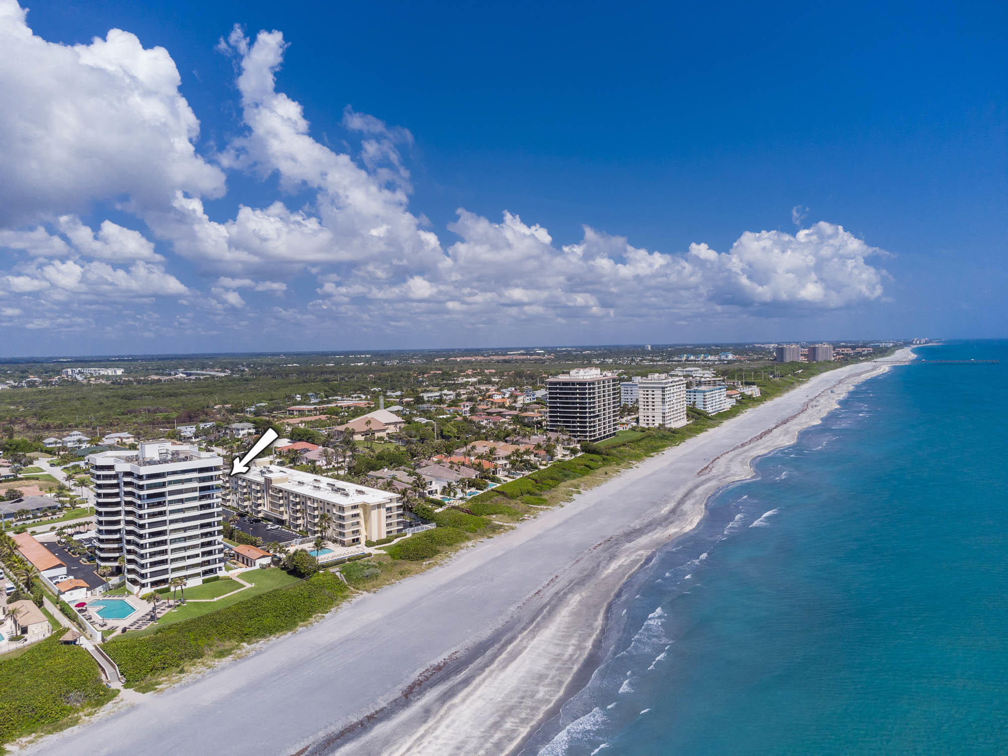 Surround yourself in Juno Beach's beautiful teal waters! Up on the 10th floor of this ocean front building, the shades of blue welcome you the moment you walk in the door. Enjoy your sunny ocean views any time of day as you stay shaded on the northeastern directed wrap-around balcony. The kitchen is set for entertaining with an open floor plan, beverage fridge, and dining space adjacent to the balcony- open all your sliding glass doors and enjoy indoor/outdoor living. A true master suite with large walk-in closet and en-suite bathroom gives you privacy from your guests with coastal wood finish on the ceiling. The unit is fully protected with accordion hurricane shutters and this condo can be sold furnished or unfurnished. Horizon condos is a beautifully maintained building with his & her saunas, fitness room, pool and beach access via the private boardwalk. One pet under 30 lbs per unit allowed.