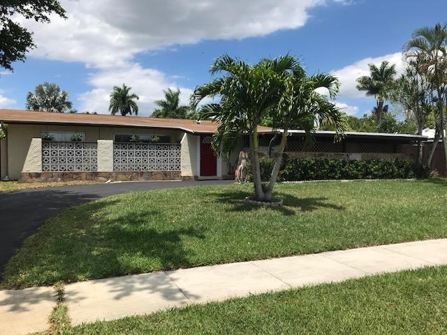 Welcome home! As you enter the home a large living room opens before you and you know you have found home.  The home is open, bright and spacious.  Featuring a updated kitchen and baths, tile floors throughout, three bedrooms and 2 bathrooms.  Neutral colors throughout.  The best is the large lap style swimming pool to enjoy on those hot Florida afternoons.  Home features updated appliances in the kitchen and laundry room.  It has a updated roof and a new hot water heater.  View this home and fall in love!