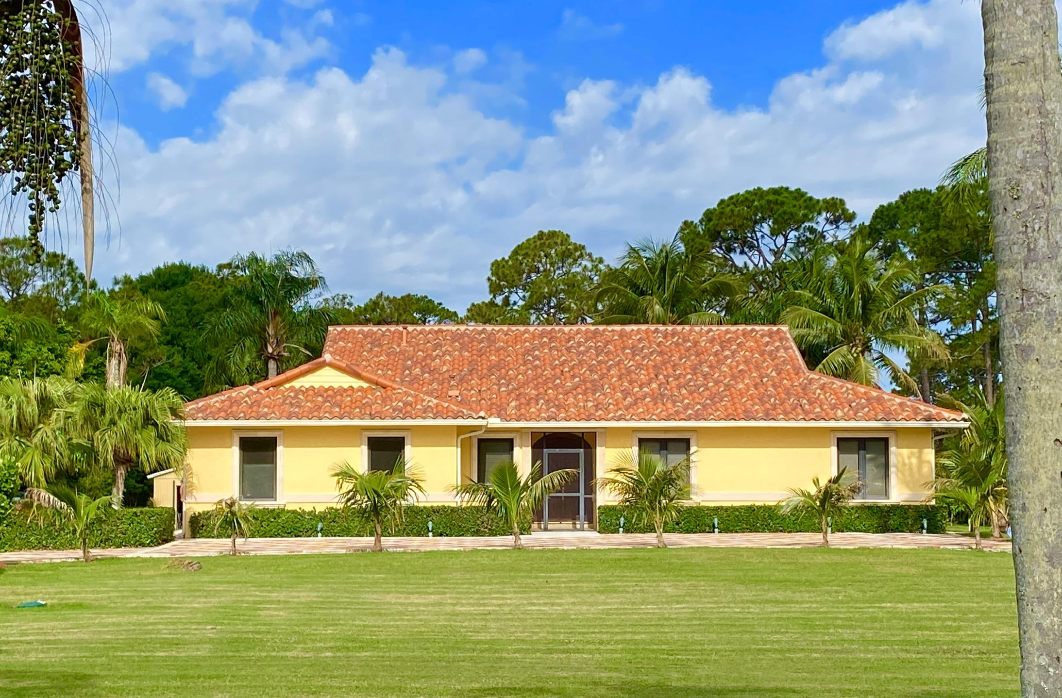 Beautiful Meditteranean High Quality CBS Pool Home on 1.25 acres. Continuous Travertine Floors throughout the ENTIRE home. High volumed and vault ceilings, Travertine walls and marble counters in both bathrooms, Large 22'x21' Open Kitchen with Gas range/oven, Large counter area for entertaining, Full Pantry, Floor to ceiling cabinets open to the Pool Area, 18'x14' Formal Dining Room, & 23'x20' Living Room Area open to the Pool, 2 1/2 Car Garage with Epoxy Flooring, Inside Laundry room, Approximately 60'x50' of Pool Patio with Freeform POOL. Updated Thermal Insulation in attic (FPL $140-$180), solid wood doors, marble baseboards, FULL hurricane protection, Large decorate driveway with Electric Gates and Lights, automatic sprinklers, Fruit Trees, Property located on Paved Road.