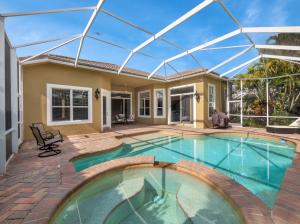 Expansive patio and resort style pool with spa