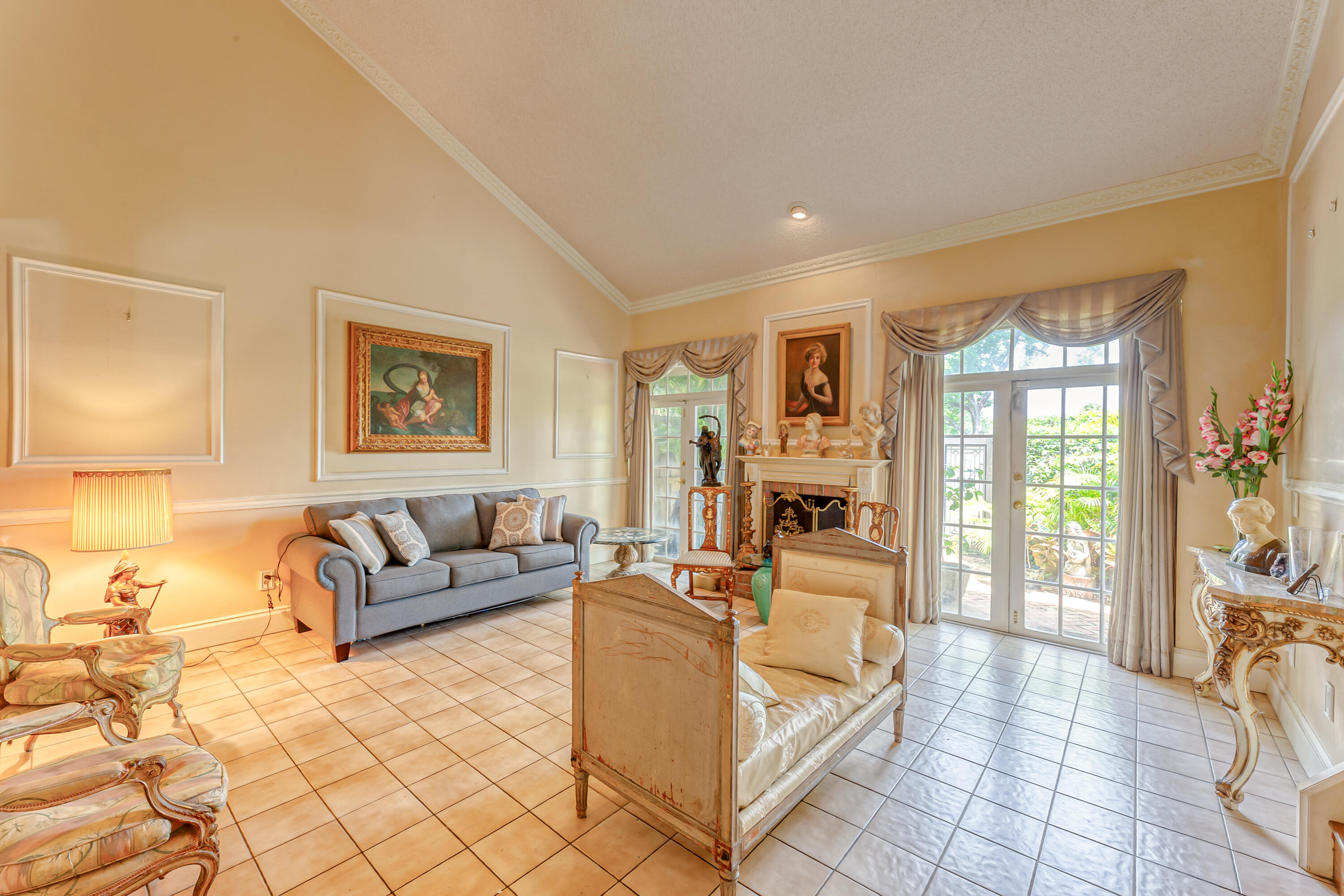 Townhouse in Sierra Del Mar. Largest fl. plan w/ pool on the lake.  4BED/ 2 1/2 BATHS...Portion of large upstairs loft  made into a 4th bdrm with w/w closet.  2 car gar.1911 s.f. under a/c. LR has vaulted ceilings & a fireplace. No carpet..1st fl. all tile, stairs & second floor all hardwood.   French doors from kit take you to the pool with new pump.French doors in living room take you to the patio w/ Chicago brick.  Gate on back patio opens to the lake with a great view of the fountain. Kit. is 10 yrs. Lots of closets & storage.  Updated baths with designer fixtures.  Crown moulding.  BDRM 2 & 3 have sliding doors leading to an upper open deck overlooking the pool. Accordian shutters & hurricane windows. Del Prado Elem. Walking distance t