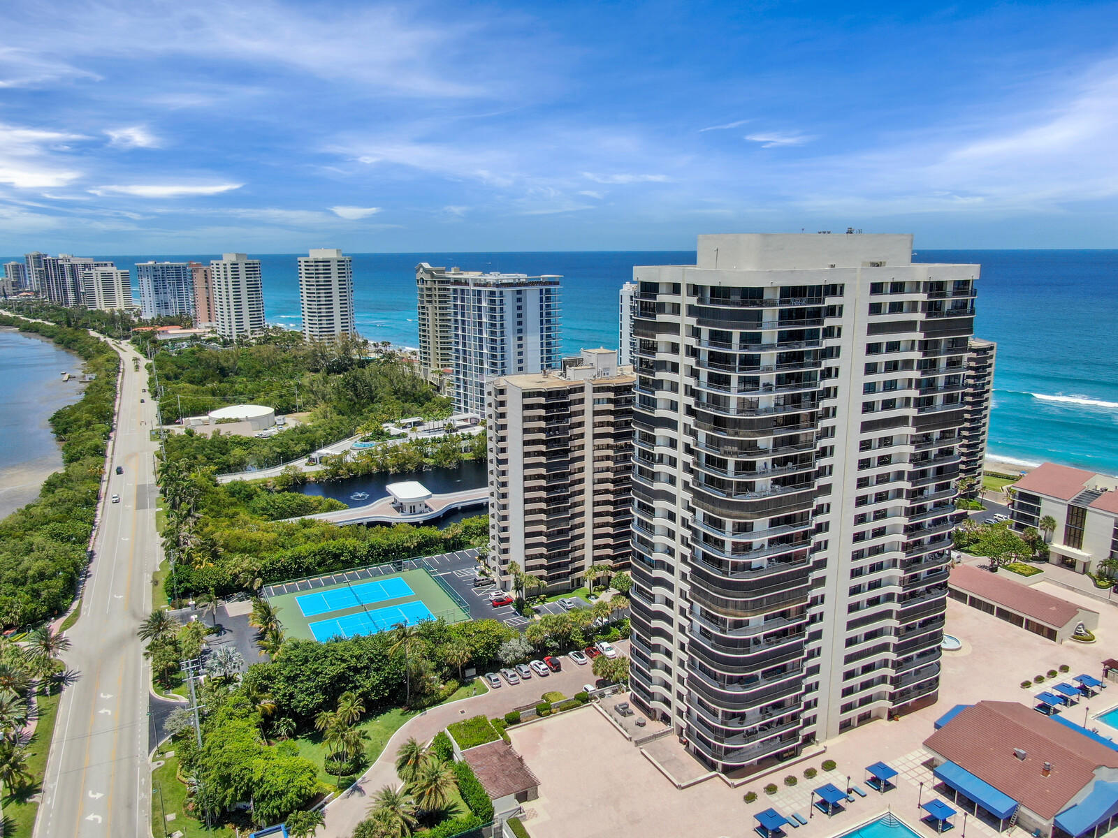 Updated 3BR 4BA at Martinique II West Tower 503. This spacious elegant condo with wrap-around balconies w/palm treed views from 5th FL NW corner overlooking intracoastal waterway. Enjoy panoramic western sunsets + night lights across pastel evening skies. Offered furnished. King bed master, Queen bed BR 2,  Full Size Sofa Bed Den/3rd BR. Kitchen area features a sunlit eat In breakfast area. Interior Full Size Laundry. Tankless Water Heater.  Hurricane Shutters,  2 Pets 20 lbs and under welcome! Garage Parking #85. Amenities include the ''Q'' Poolside Restaurant & Bar exclusively for residents, 2 heated pools for families and adults, jacuzzi hot tub, 2 tennis courts + fitness centers. Residents lounge w/catering kitchen, billiards, card room + library, 24 hr guard gate + lobby concierge.
