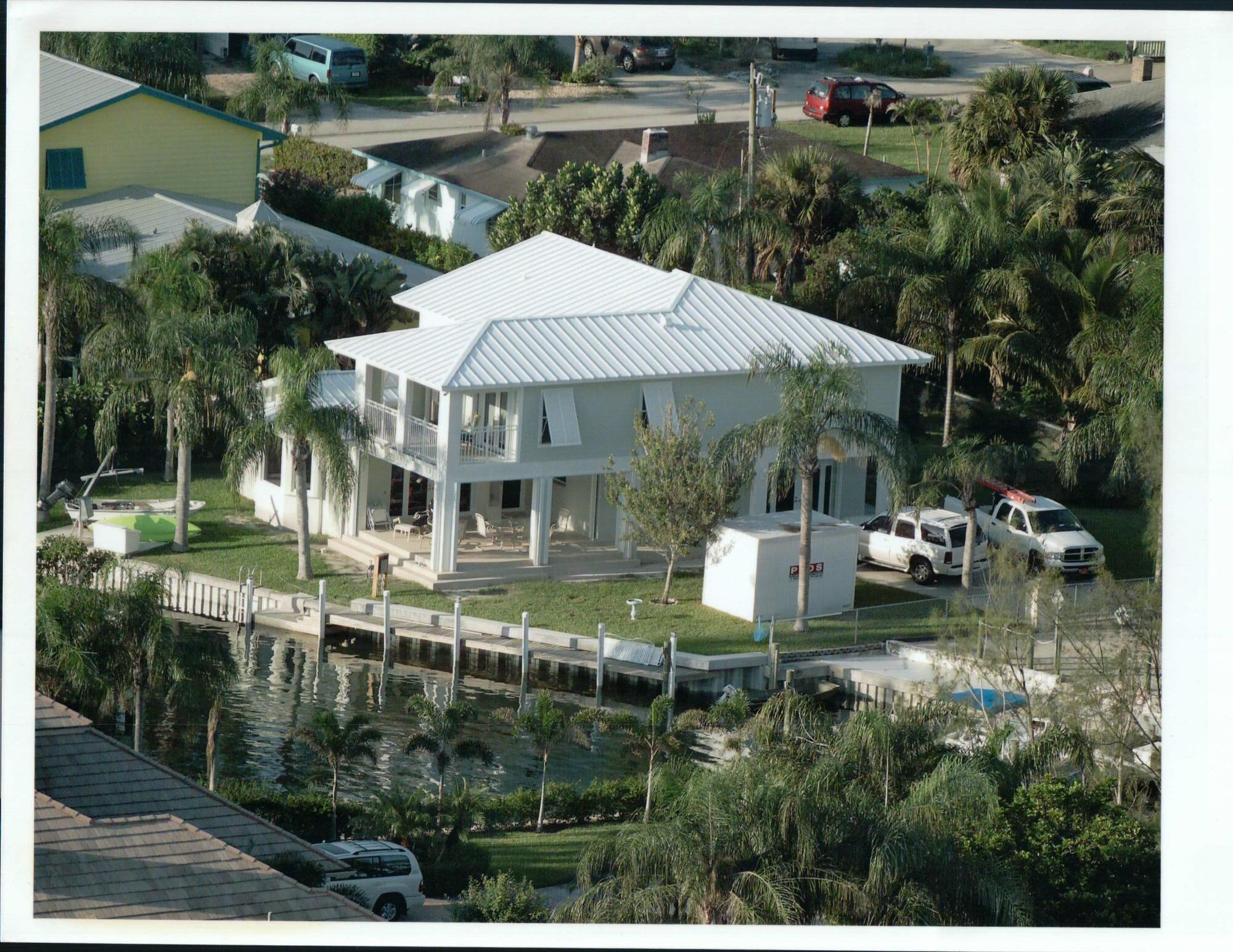 This 2 story Key West style 3-bedroom, 3-bath home situated on a tranquil protected canal just off the intracoastal. Just minutes from Jupiter Inlet. Oversized lot with 105' canal frontage with boat and jet ski lifts. Generator and security cameras. Main floor features open concept floor plan with Chef's style kitchen featuring a large cooking island with stainless range hood and appliances. Guest suite with full bath. Second floor features a large master suite with his & her walk-in closets and large master bath. Vaulted ceiling and large balcony over-looking the intracoastal waterway. Second bedroom with full bath. An optional room for office or crafts. This home is a perfect oasis for entertaining outdoors and a boating lifestyle. Conveniently located near shopping and recreation.