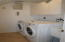 laundry room with new tub