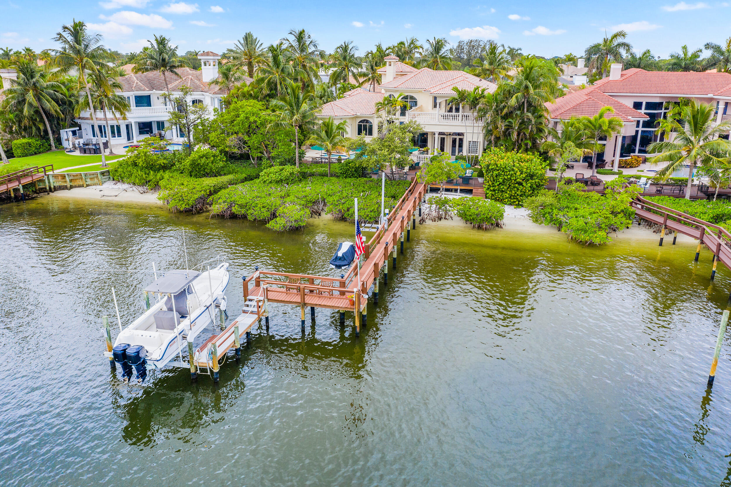 COME SEE THIS CASSEEKEY ISLAND GEM! This sought-after location in one of Jupiter's top selling, non-mandatory club, communities is a private enclave of 63 homes on navigable salt water. Jonathans Landing has a 24 hour manned gate and endless club amenities. Close to all Jupiter has to offer; restaurants, shops and some of the finest beaches in Palm Beach County. This Traditional style home sits on 100 ft of waterfrontage, complete with 4 bedrooms, 6.5 bathrooms, large ground floor master suite with His/Hers closets, den, kitchen, remodeled in 2018 with top of the line appliances. Exterior Features include a private pool, spa, fire pit, cabana bath, outdoor shower, large deck with custom lighting, 2 covered balconies, 1 open balcony facing West (for the sunset watchers). (See Supplementa The best part is being able to launch your paddle board/kayak from your private beach right next to the 105 foot fingerling dock complete with two jet ski lifts and a 12,000lb lift to accommodate up to a 38 foot boat. Come live in paradise!!