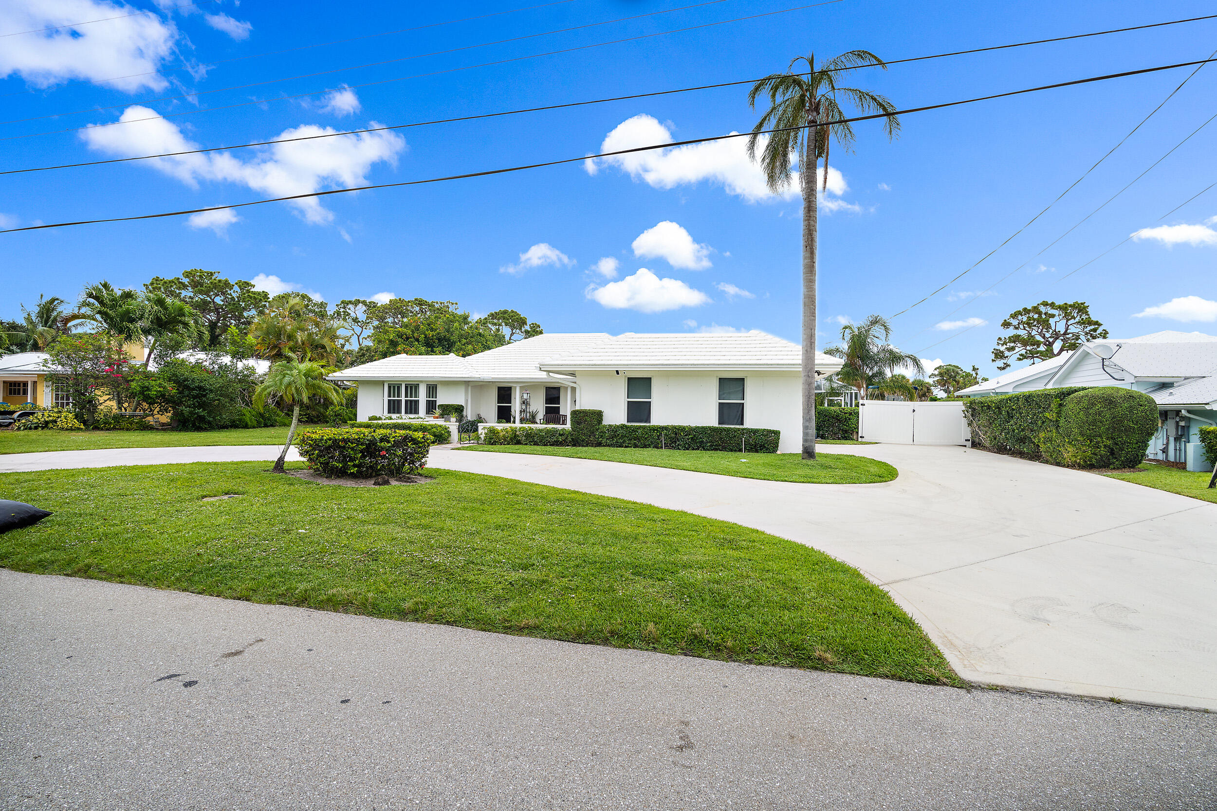 Location, Location, Location!!!Beautiful single family home in the heart of Tequesta.  Located across from boat ramp and on the golf course just minutes away from shopping, restaurants and the beach. Step inside this wonderful home offering a split bedroom floor plan, 3 bedrooms, 3.1 bathrooms, 2 car garage and a great screened in pool.Brand NEW 2020 roof, AC 2014 and water heater 2021.  All Newer kitchen appliances, wood floors and generously sized bedrooms. Dont miss out seeing this GEM!