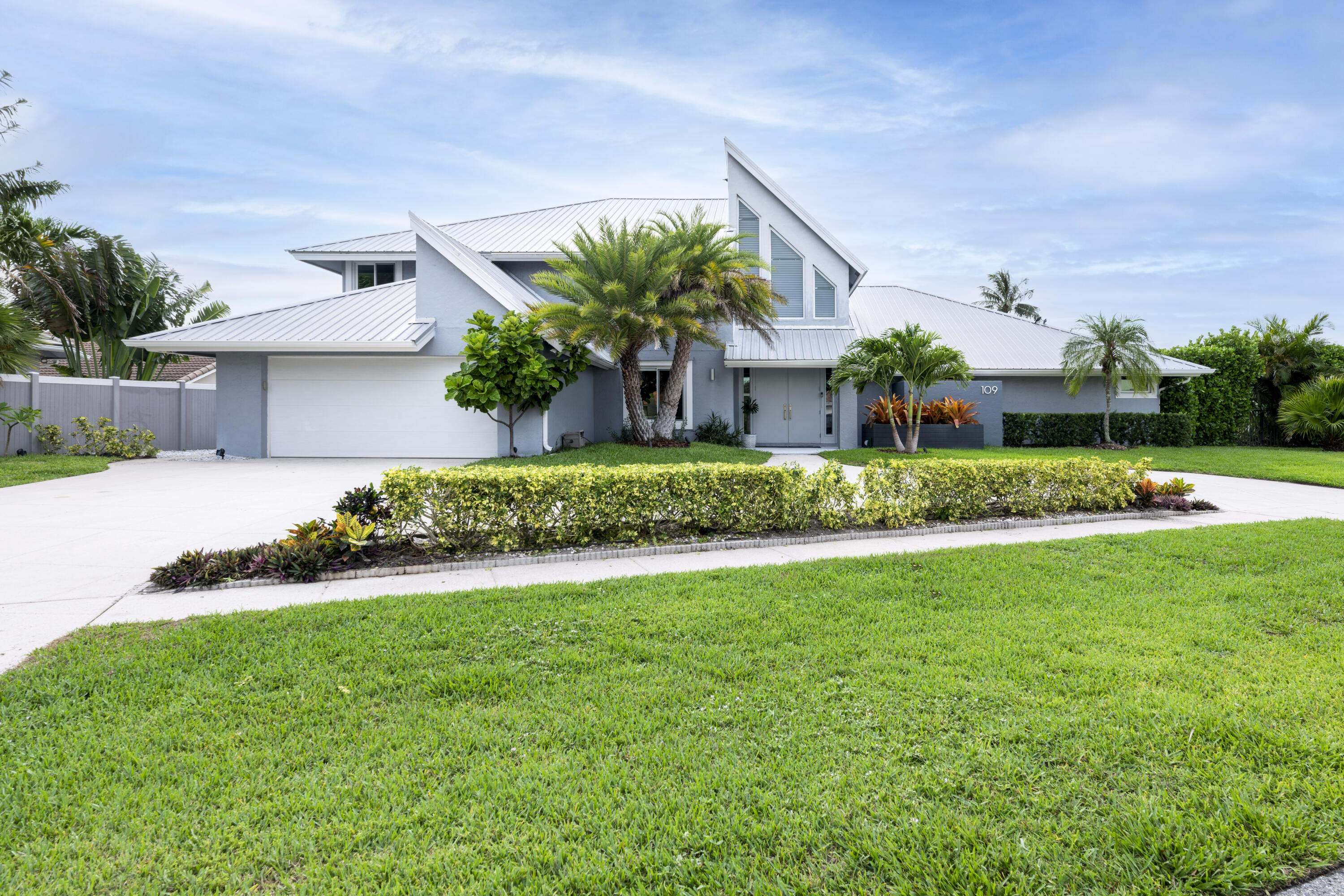 Stunning high-end contemporary design in OLYMPUS w/deeded beach access! Perfect for open space entertaining, living & relaxing in private setting close to Beach, Intracoastal and commerce! Completely remodeled 6BR/4BA bright home w/soaring ceilings. Chef's kitchen w/Wolf 6-burner gas range, SubZero 48'' PRO w/glass door, 2 dishwashers. Huge pantry/baking zone w/sink, clear ice maker. MBR w/Spa-like BA, huge closet. Guest Suite (sleeps 6) w/pool access . Huge Laundry Room w/Thermador fridge. 2nd Floor w/HUGE loft/office area, plus 2 BRs! Private landscaped yard offers large pool, luxurious Hot Tub for 10 & outdoor kitchen with grill, sink and fridge. Covered & open patios. Impact Glass and doors, Aluminum Roof 2011, CBS construction. There's so much more - PLEASE READ Detailed Features List