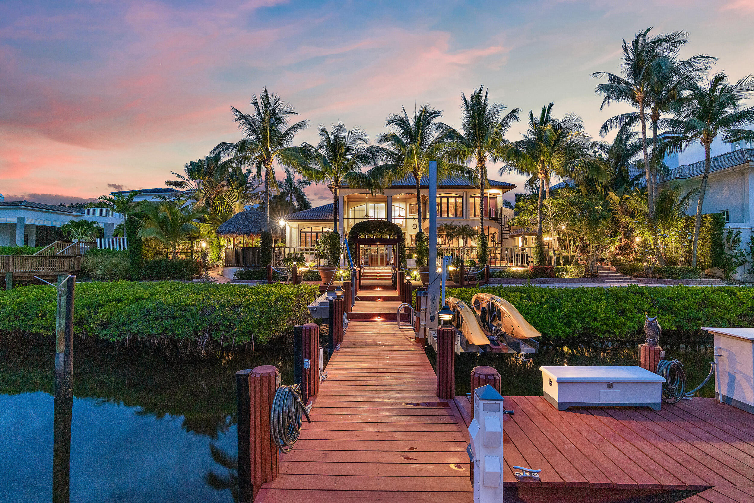 This Waterfront Estate is perfect for the Buyer that wants it all!  Located on a private island street with waterfrontage that can accommodate a large vessel.  Easy access to the Intracoastal and it is close to all the 5 star amenities that Admirals Cove has to offer.   The custom built, Tuscan inspired home, is over 5,800 square feet with a perfect blend of formal and casual living.   Lush landscaping, custom wood work, 5 bedrooms, one of which is a private guest apartment, screened in patio, dock for 2 boats with a 12,000 lb. lift and swing lift for jet skis or kayaks, 60 k generator, air conditioned 4 car plus golf cart garage and so much more!  This home is classic sophistication and timeless elegance at its best.