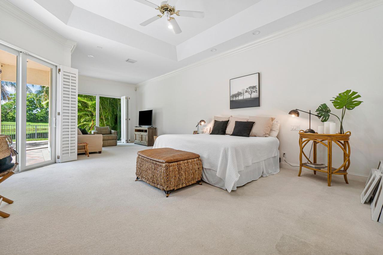 Master bedroom overlooking pool area