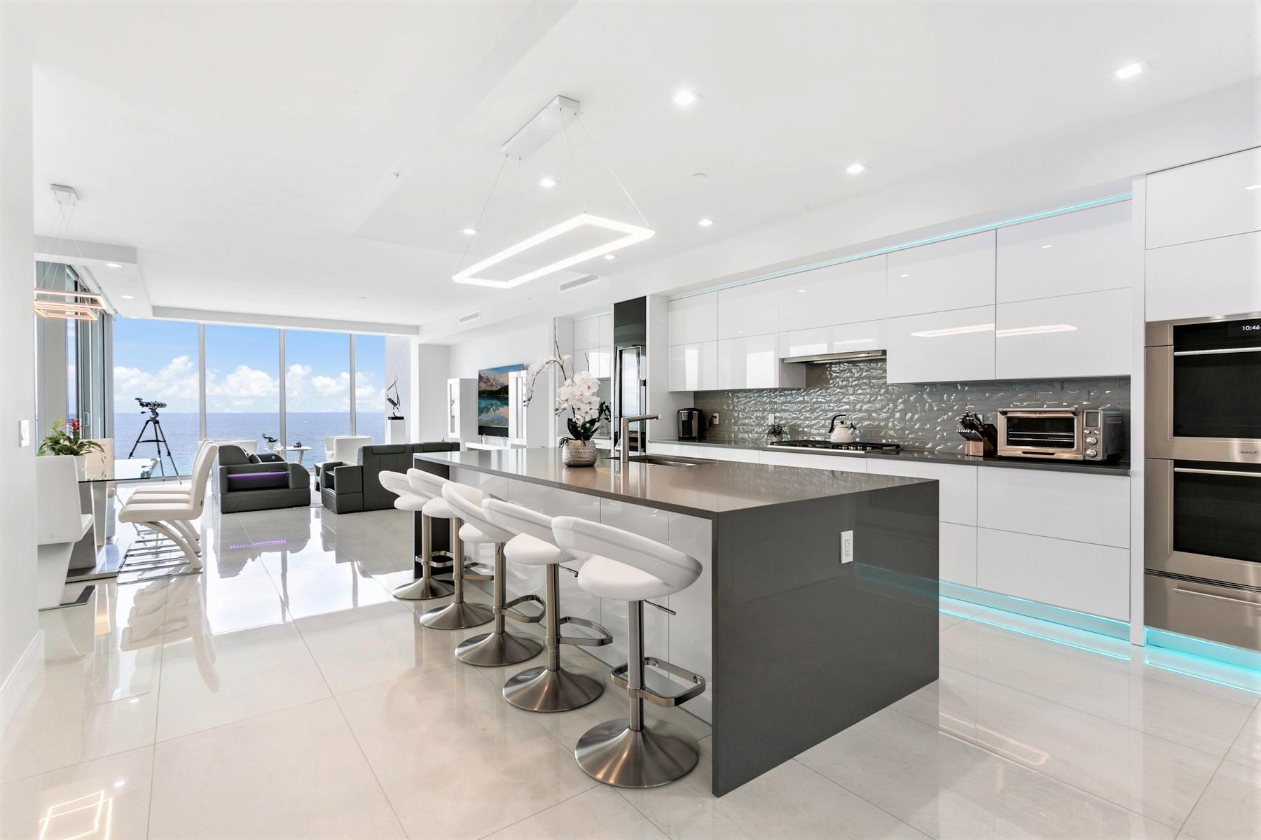 Live in the most luxurious boutique oceanfront building on Singer Island. No expenses were spared to upgrade the interior with high end finishes. The kitchen features solid wood, high gloss laminate finish cabinets with Electronic Auto Touch mechanism. Kitchen, baths and laundry room feature slate colored quartz counters to compliment the white cabinetry. All closets and the extra large pantry were upgraded with custom built-in cabinetry. Remote control window shades by California Design were installed throughout the condo. The game and family room can be accessed through a glass barn door and features a short throw projection TV with Sonos surround entertainment system. The Control 4 Smart Home System allows you to adjust music, ac, window shades and more from your mobile phone. Modern lighting/chandeliers and new LED recessed lighting have been installed throughout. Furniture was designed by Zuri and Sofa Dreams; some pieces will be exchanged. Furniture is negotiable. The kitchen is still waiting on finishing touches, as well as the Master Bath. Once completed there will be new photos available. Please note that the seller can close no earlier than the last week of December 2021, however, arrangements can be made for pre-closing occupancy. Showings start June 15, 2021. Taxes for 2021 have not yet been established.