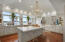 Granite Counters, Stainless Steel Appliances, Built-In Oven, recessed ceiling with custom lights.