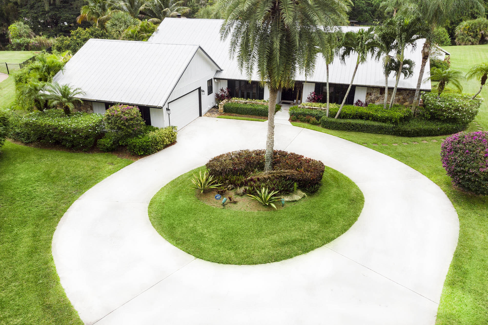 Find true, refreshing privacy in a secure gated community with this private, cul de sac, over-sized, water-side, premier lot.  Complete with a well-cared for, easy to love , solidly built-home, cottage, gazebo and generous pool.  We have just the home and 1 1/3 waterfront acre, all facing just about nothing but elegantly tall greenery, for you!  BEST STREET LOCATION IN STEEPLECHASE....One-of-a-kind ...Spectacular 1.03 acre property on a private quiet cul-de-sac, man-gate security with roaming security 24/7. Quick access to the heart of Palm Beach Gardens and the North gate on to Northlake. Minutes to I-95, Florida Turnpike, shopping, schools, golf, and Palm Beach International Airport. This one-story split floorplan has 4 large Bedrooms/2.1 Baths in the main house and a 1 large Bedroom, LR and 1 Bath in the guest house, a screened porch, large pool, gazebo and a one-bedroom guest House. The large informal living room is enhanced by a gorgeous wooded ceiling and a real wood-burning fireplace giving it a cozy feel and is just off the kitchen giving it that wide open concept popular in today's market. The formal living and dining rooms both have Light bright interiors boasting huge windows and sliders bringing in the gorgeous manicured outdoors into every room. Enjoy sitting out in the gazebo looking down at the wide flowing canal waterways. Kitchen has been updated with a Kenmore Elite Appliance package with double ovens and a flat separate cooktop. This traditional home boasts an energy-efficient metal roof, hurricane safe windows and doors, a separate outdoor electrical connection for the generator and lots of improvements over the years; metal roof, kitchen, updated electrical, pool and more. LOW HOA fees in this exclusive relaxing community of single-family homes all having over an acre of land. Bring your toys, kids, family, friends, and take in the outdoors in the privacy of your own home! BONUS for this quiet waterfront secluded property is its adorable separat