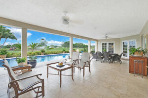 expansive covered patio with open golf course veiws