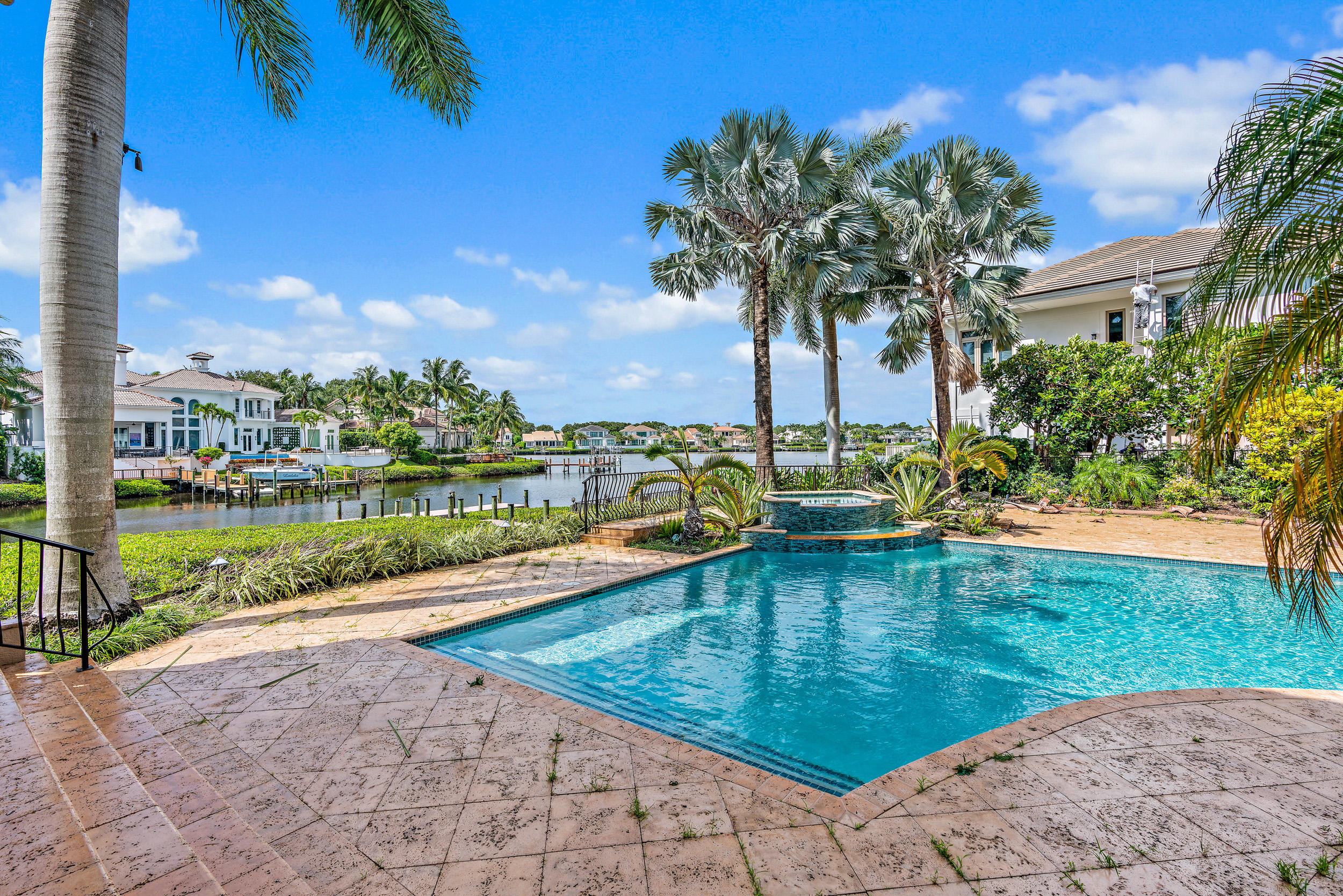 Waterfront Estate home with over 8,100 square feet of luxury living.  Located on a tree lined, cul-de-sac street in the highly desirable Admirals Cove.  Close to all the amenities and perfectly situated on over 100 feet of waterways with Intracoastal access.   The home features 5 bedrooms, a theater room, impact windows, fresh paint, fine craftmanship and materials and so much more!