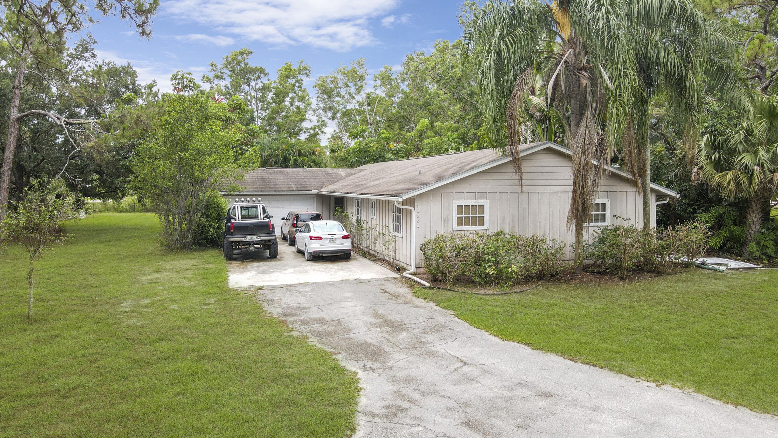 A private retreat with a private pool, over an acre of land and lots of space. And a bargain because of short sale. Hurry to see this 4/2/2 priced to sell.