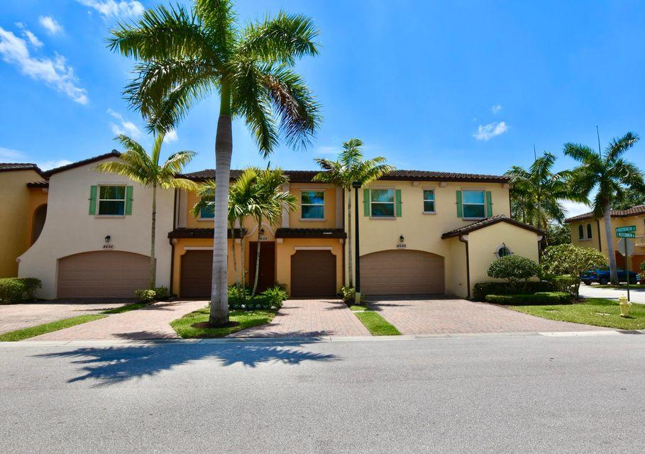 Move in ready! 2014 Built Townhouse in Highly desirable Palm Beach Gardens. Full IMPACT Windows, updated Appliances and light fixtures, Fresh Paint, Crown Molding. 2 separate Paver Driveways enough to park 4 cars plus Garage space. Additional Kitchen SqFt added by the builder. UV-C light upgrade in Air Handler. Maytag Washer and Dryer included. One Owner. Private Backyard. Home Security System, Minutes to shopping, beaches, hospitals, medical facilities and I-95 & Turnpike