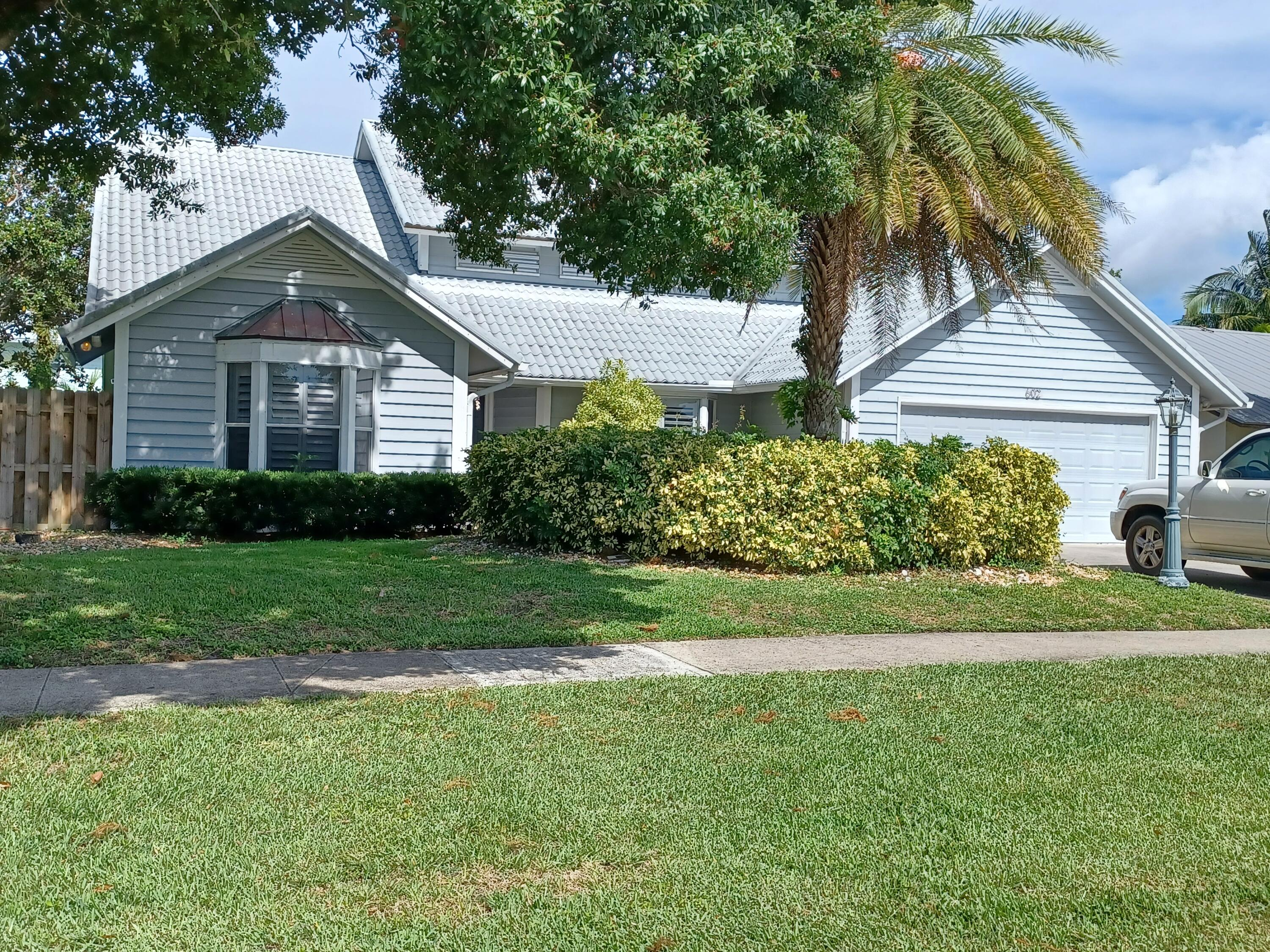 Beautiful custom built Waterfront home in the heart of Jupiter. Home boasts 2 docks and boat lift. Perfect place for any water escape-kayak, paddle board or boat directly to the Loxahatchee River & Intracoastal waterway. Best news: NO HOA. 2 BR, optional 3BR/Den & 2 full baths on the 1st floor, on the 2nd floor you will find your own personal oasis a beautiful master suite with a large deck over looking the pool. New floors, bathrooms remodeled, refinished kitchen cabinets, granite counters, backsplash, new hardware, new pool filter, cleaner & heater, new AC unit & lovely lightening. Exceptional floor plan has large family room with wood burning fireplace, stone hearth & wet bar. Great entertaining House. Lovely pool with screened deck area.